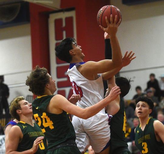 Reno's Skylar Hales shoots while taking on Bishop Manogue during their basketball game in Reno on Dec. 14.