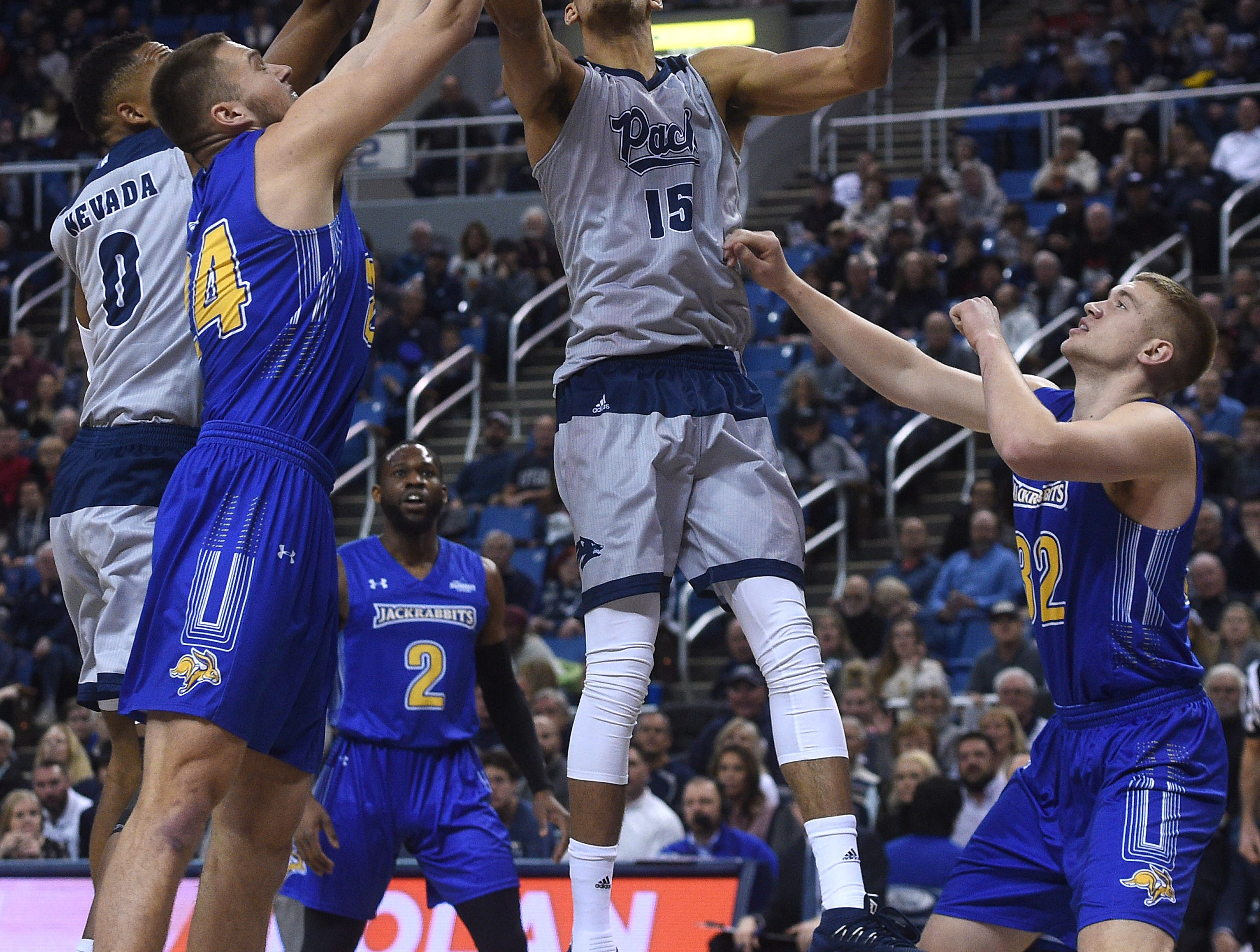 Nevada's Trey Porter (15) grabs a rebound while taking on South Dakota State during their basketball game at Lawlor Events Center in Reno on Dec. 15, 2018.