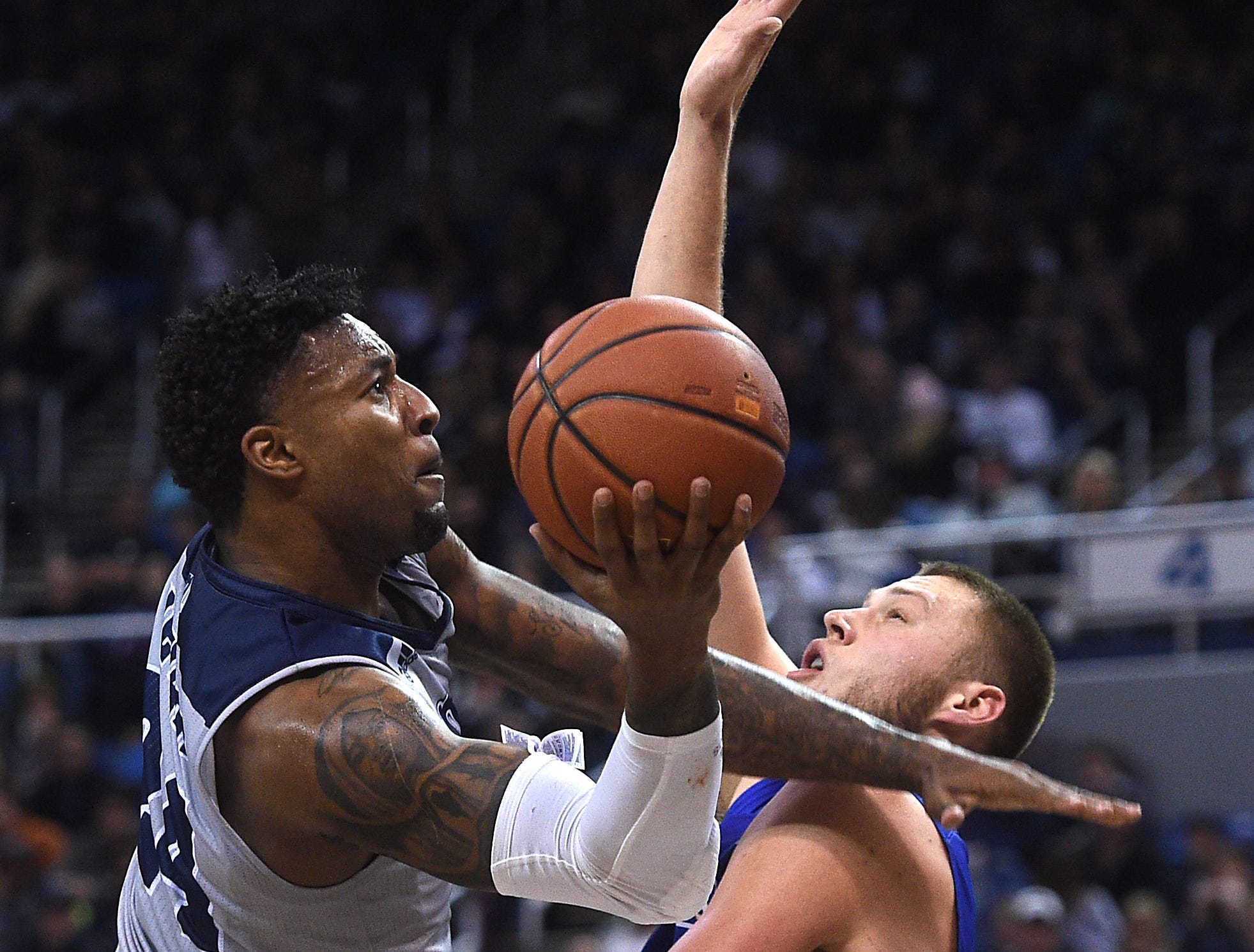 Nevada's Jordan Caroline shoots while taking on South Dakota State during their basketball game at Lawlor Events Center in Reno on Dec. 15, 2018.