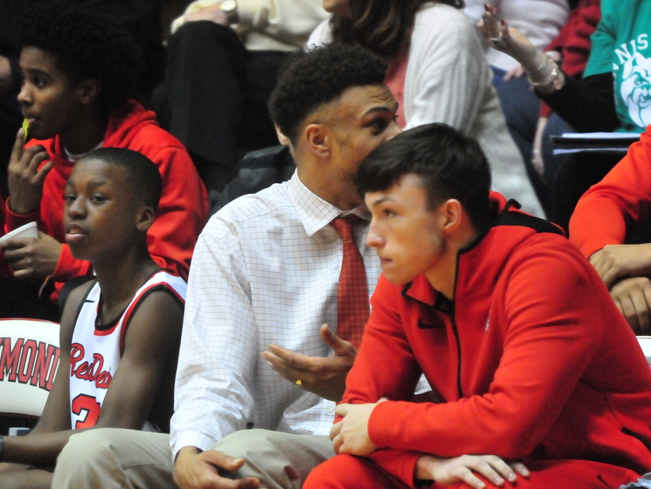 Jordan Stolle, right, sits on the bench during Saturday's 42-39 boys basketball loss to Connersville Dec. 15, 2018 at Tiernan Center. Stolle will be eligible to return on Wednesday.