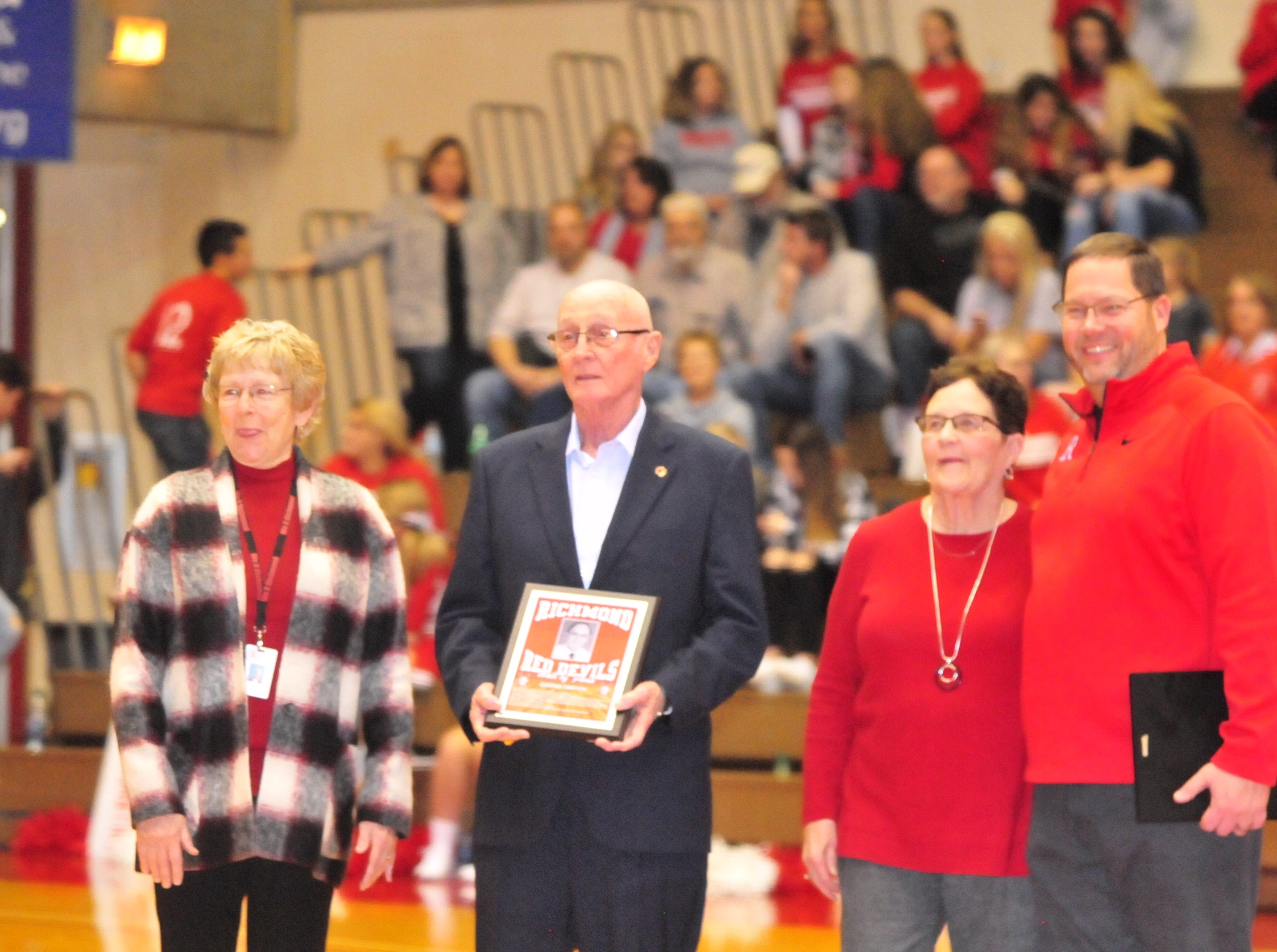 George Griffith accepts his plaque as he was one of seven inducted into the inaugural RHS Coaches Hall of Fame during Saturday's 42-39 boys basketball loss to Connersville Dec. 15, 2018 at Tiernan Center.