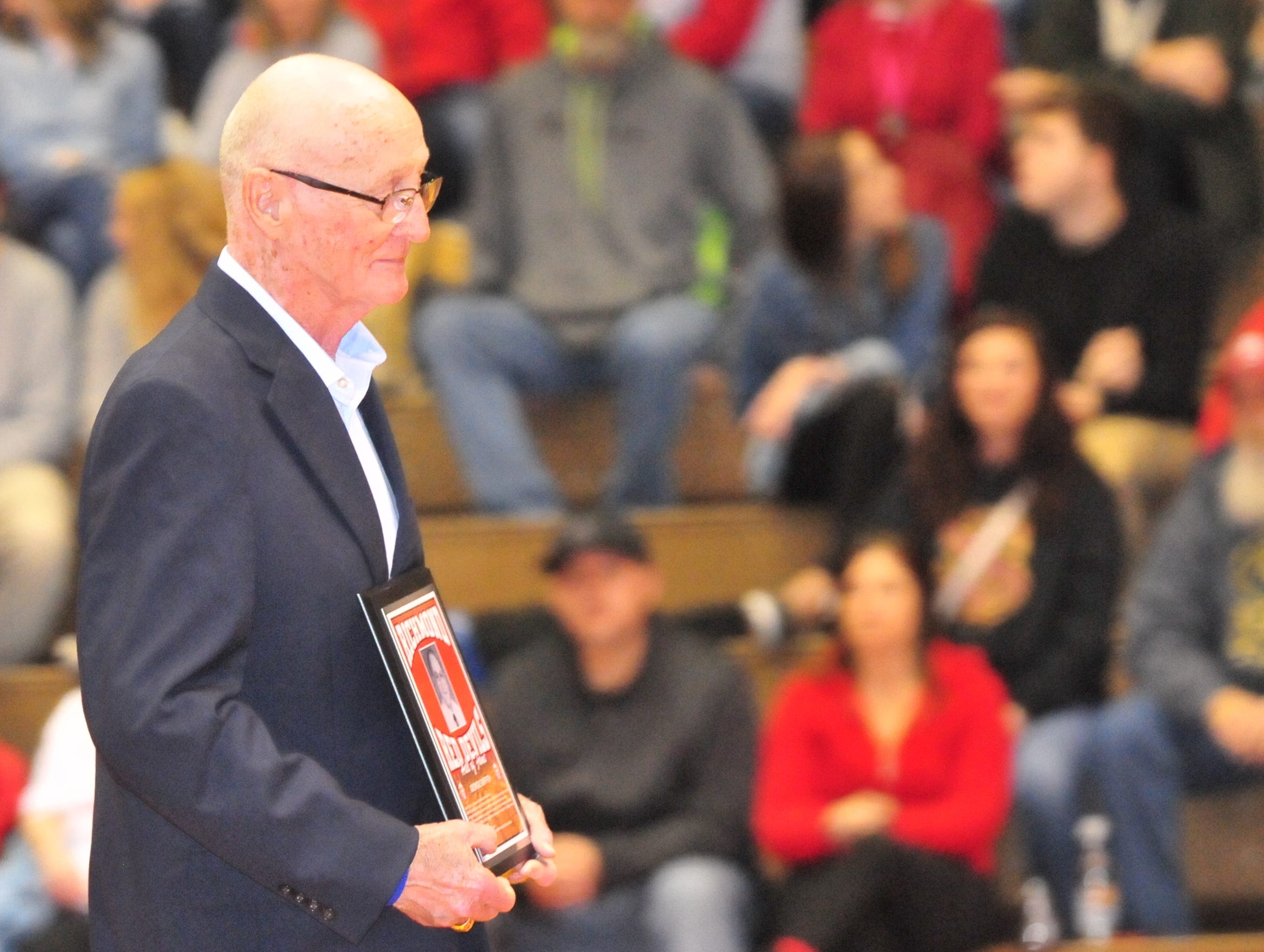 George Griffith accept his plaque as he was one of seven inducted into the inaugural RHS Coaches Hall of Fame during Saturday's 42-39 boys basketball loss to Connersville Dec. 15, 2018 at Tiernan Center.