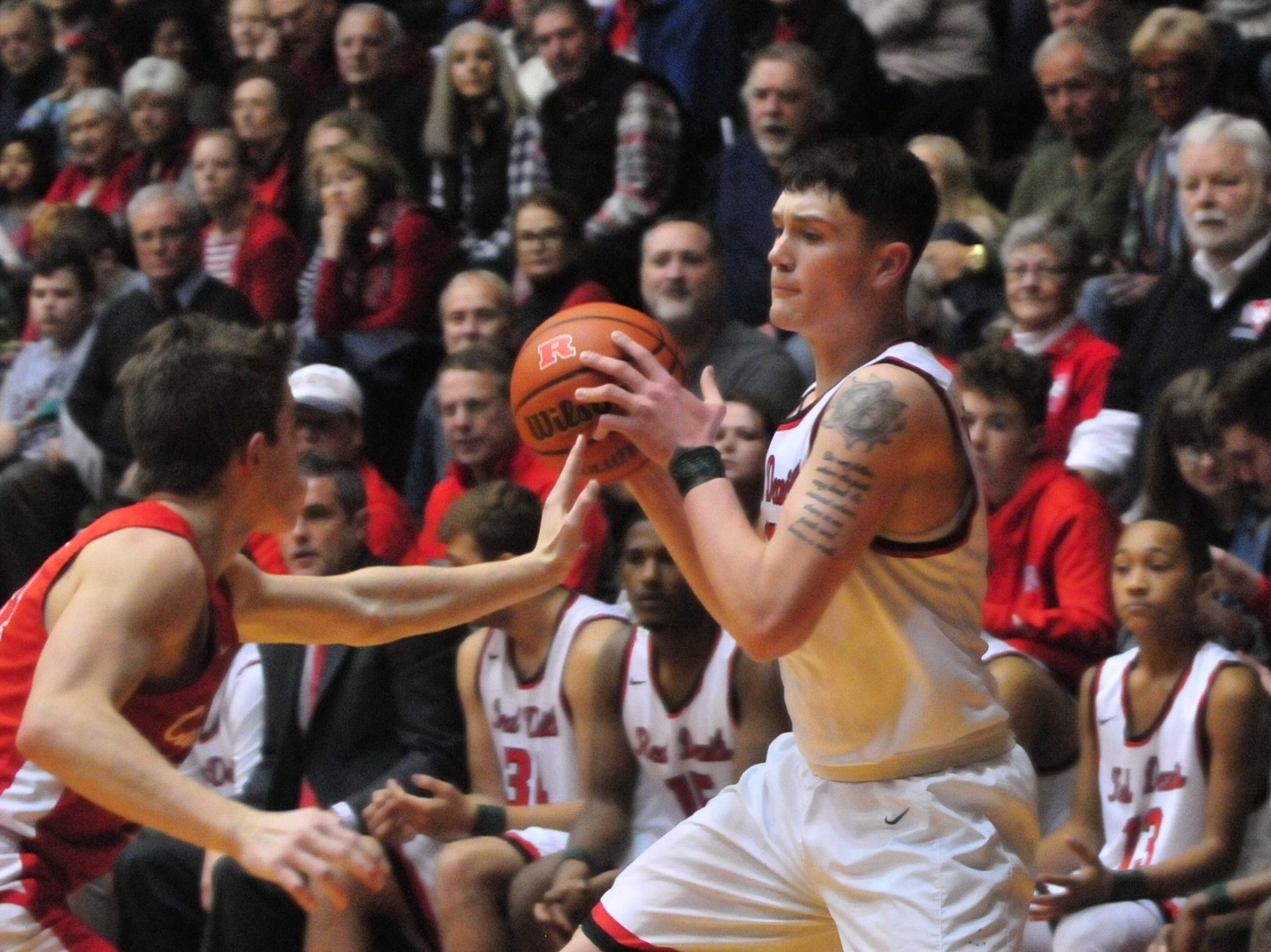 Lucas Kroft moves the ball during Saturday's 42-39 boys basketball loss to Connersville Dec. 15, 2018 at Tiernan Center.