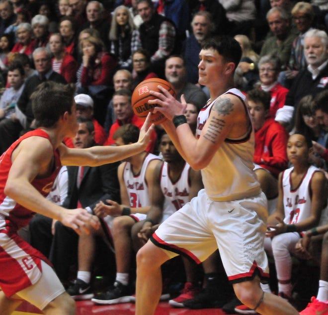 Lucas Kroft moves the ball during Saturday's 42-39 boys basketball loss to Connersville Dec. 15, 2018 at Tiernan Center.