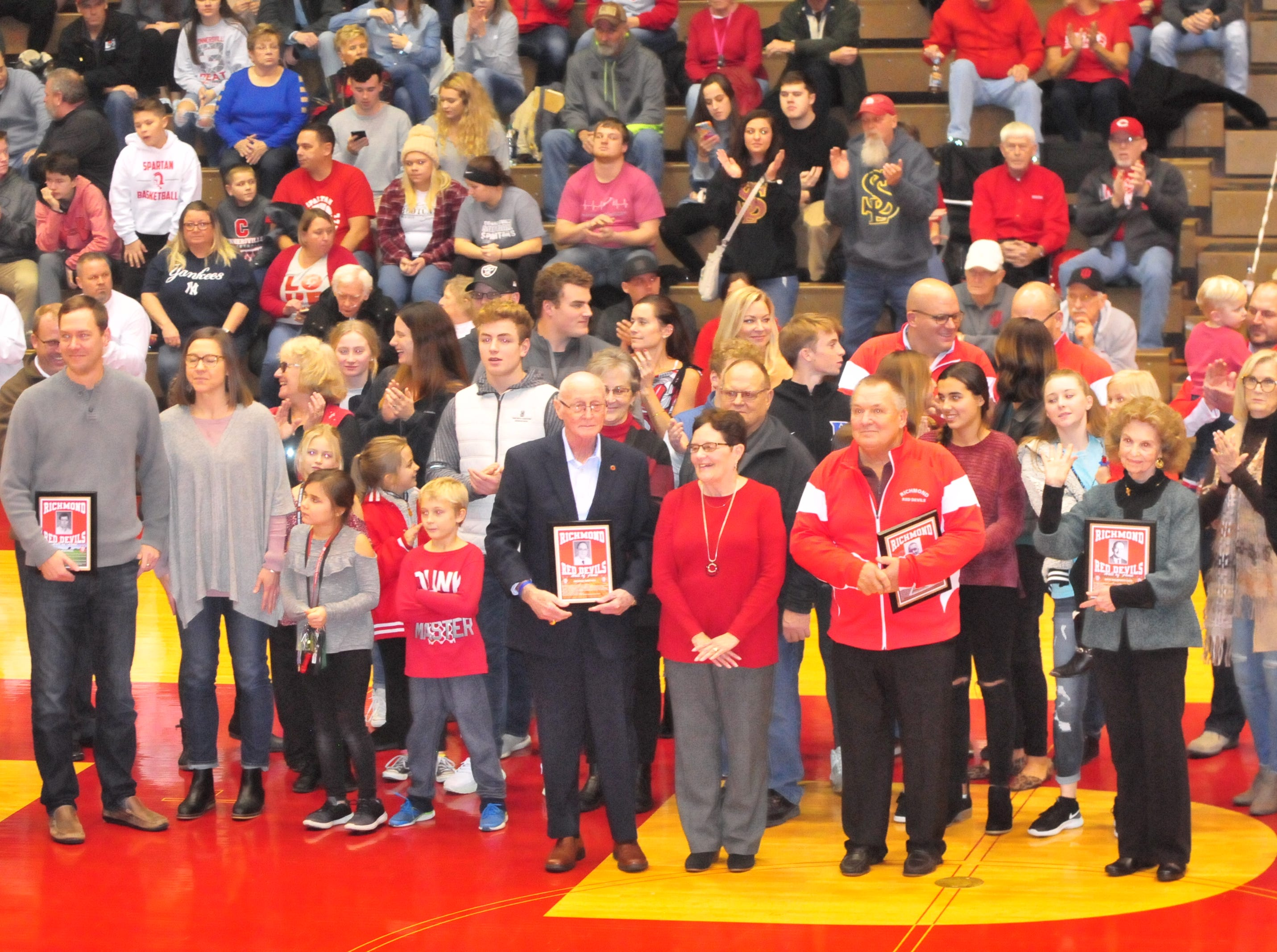 Dick Baumgartner, John Cate, George Griffith, Dave Bowers, Charlie Hilton, Joe Moehring and Hub Etchison were inducted into the inaugural RHS Coaches Hall of Fame during Saturday's 42-39 boys basketball loss to Connersville Dec. 15, 2018 at Tiernan Center.