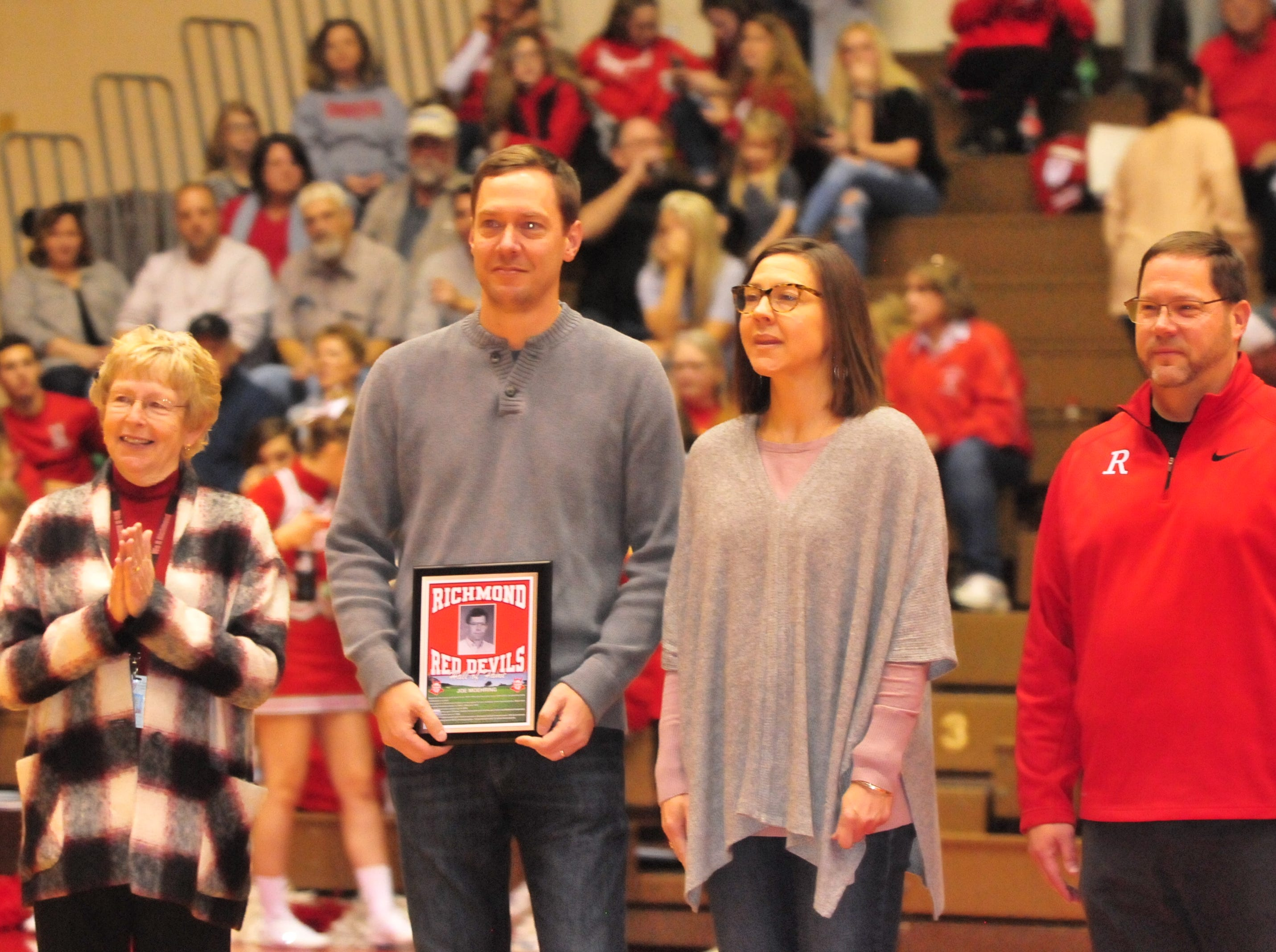 Family of Joe Moehring accepts a plaque as he was among the seven inducted into the inaugural RHS Coaches Hall of Fame during Saturday's 42-39 boys basketball loss to Connersville Dec. 15, 2018 at Tiernan Center.