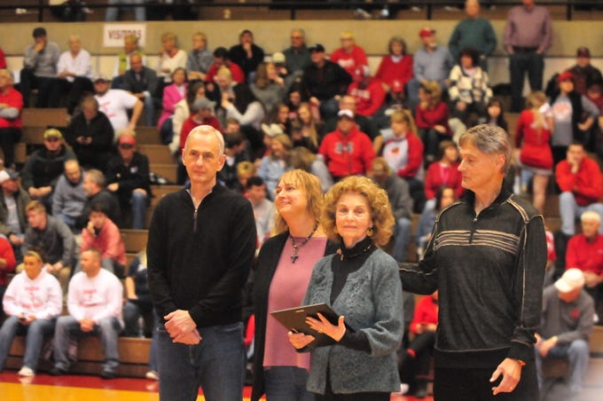 Family members of Dick Baumgartner accept his plaque as he was one of seven inducted into the inaugural RHS Coaches Hall of Fame during Saturday's 42-39 boys basketball loss to Connersville Dec. 15, 2018 at Tiernan Center.