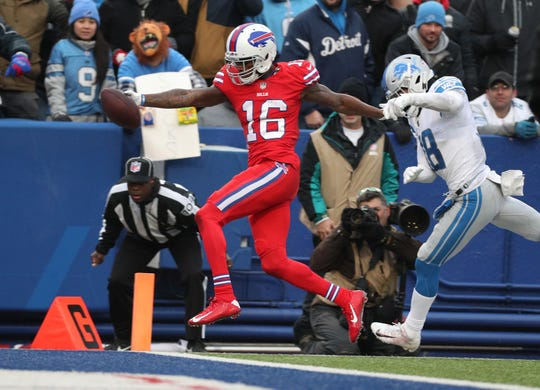 Bills receiver Robert Foster scores the game winning touchdown against Lions cornerback Mike Ford.