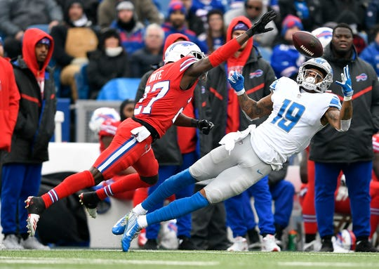 Detroit Lions wide receiver Kenny Golladay (19) catches a pass against Buffalo Bills cornerback Tre'Davious White (27) during the first half of an NFL football game, Sunday, Dec. 16, 2018, in Orchard Park, N.Y. (AP Photo/Adrian Kraus)