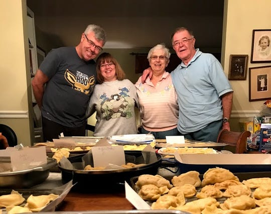Tom Schuhmacher, Sue Brown, Rose Marie Schuhmacher and John Schuhmacher pose after a day of making pierogi.