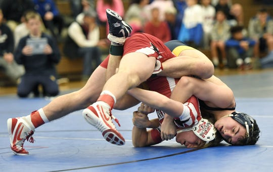 VIctor's Alex Samson, right, wrestles Penfield's Max Kropman in the Monroe County Championships 138-pound weight class finals at Webster Schroeder High School, Saturday, Dec. 15, 2018.