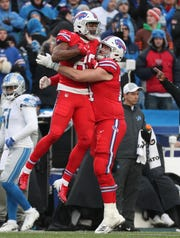Bills tight end Jason Croom is congratulated by Jeremiah Sirles (74) after Croom's 25-yard catch.