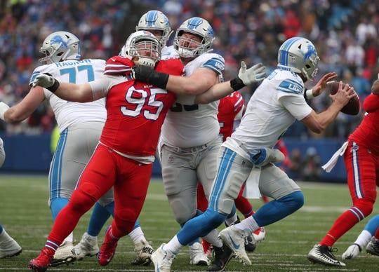 Bills Kyle Williams tries to fight through a block and pressure Lions quarterback Matthew Stafford.