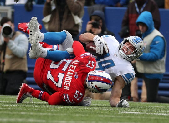 Lions running back Zach Zenner is tackled by Bills linebacker Lorenzo Alexander.