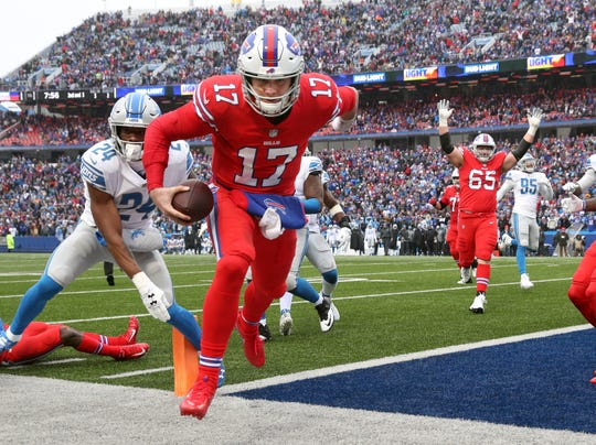 Bills quarterback Josh Allen wins a foot race to the corner of the end zone for a touchdown in the second quarter against the Lions.