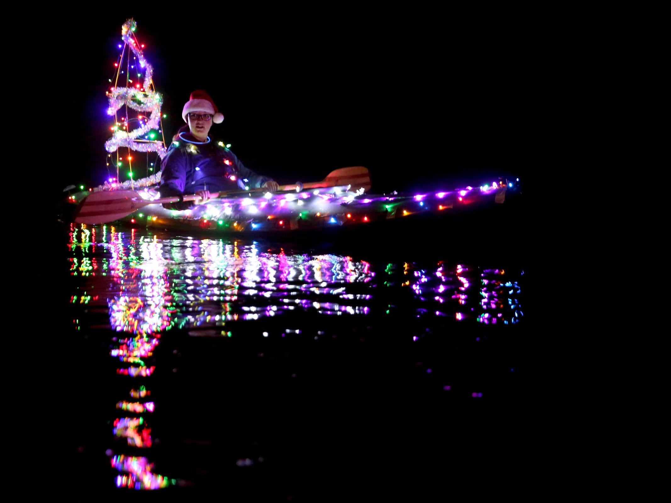 A woman kayaks during the 14th annual Winter Solstice Illuminata Regatta on the Willamette River at Riverfront Park in Salem on Saturday, Dec. 15, 2018.