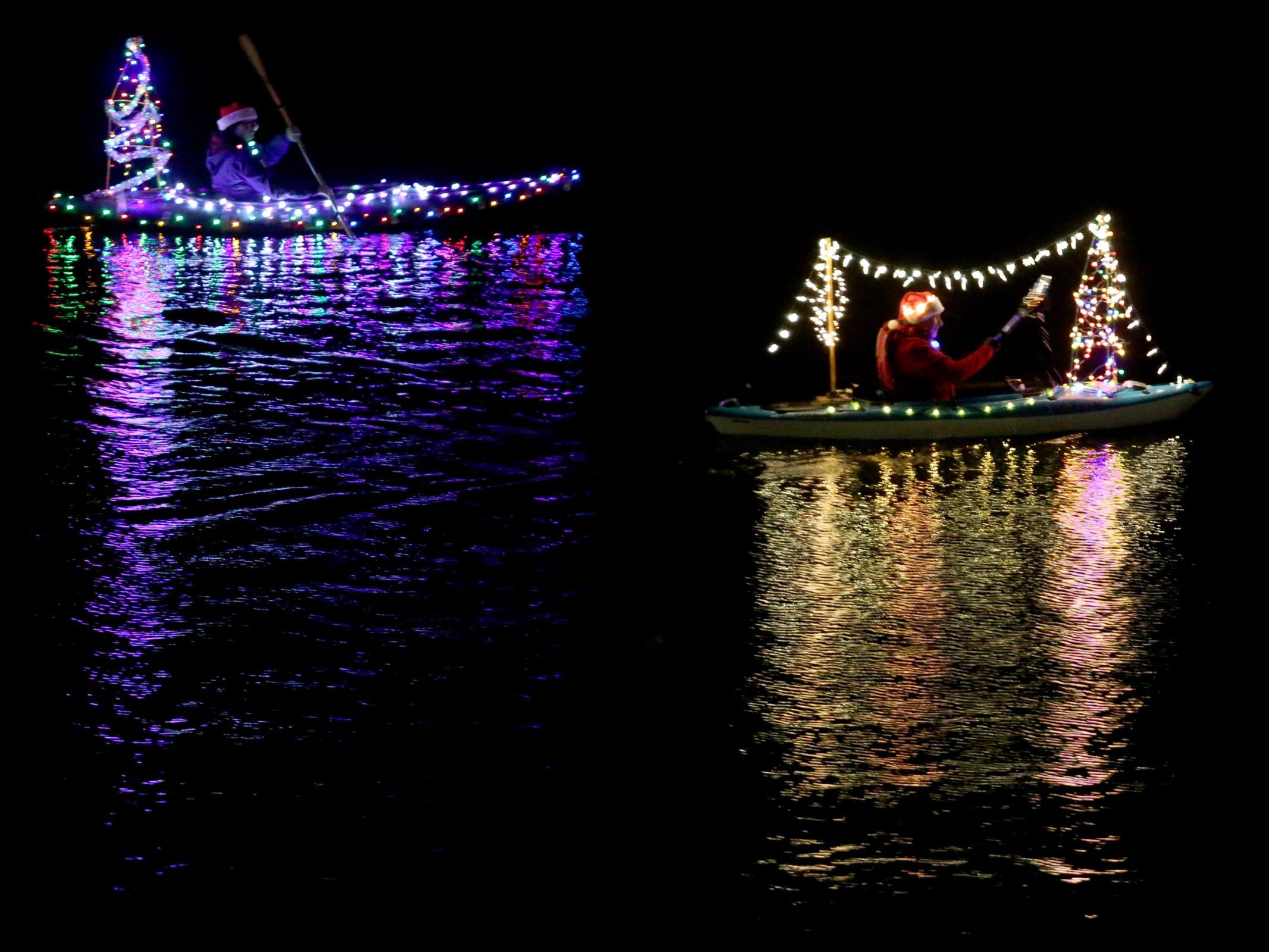 People kayak during the 14th annual Winter Solstice Illuminata Regatta on the Willamette River at Riverfront Park in Salem on Saturday, Dec. 15, 2018.