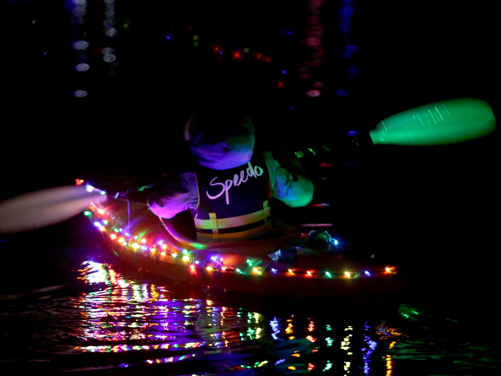 A girl kayaks during the 14th annual Winter Solstice Illuminata Regatta on the Willamette River at Riverfront Park in Salem on Saturday, Dec. 15, 2018.