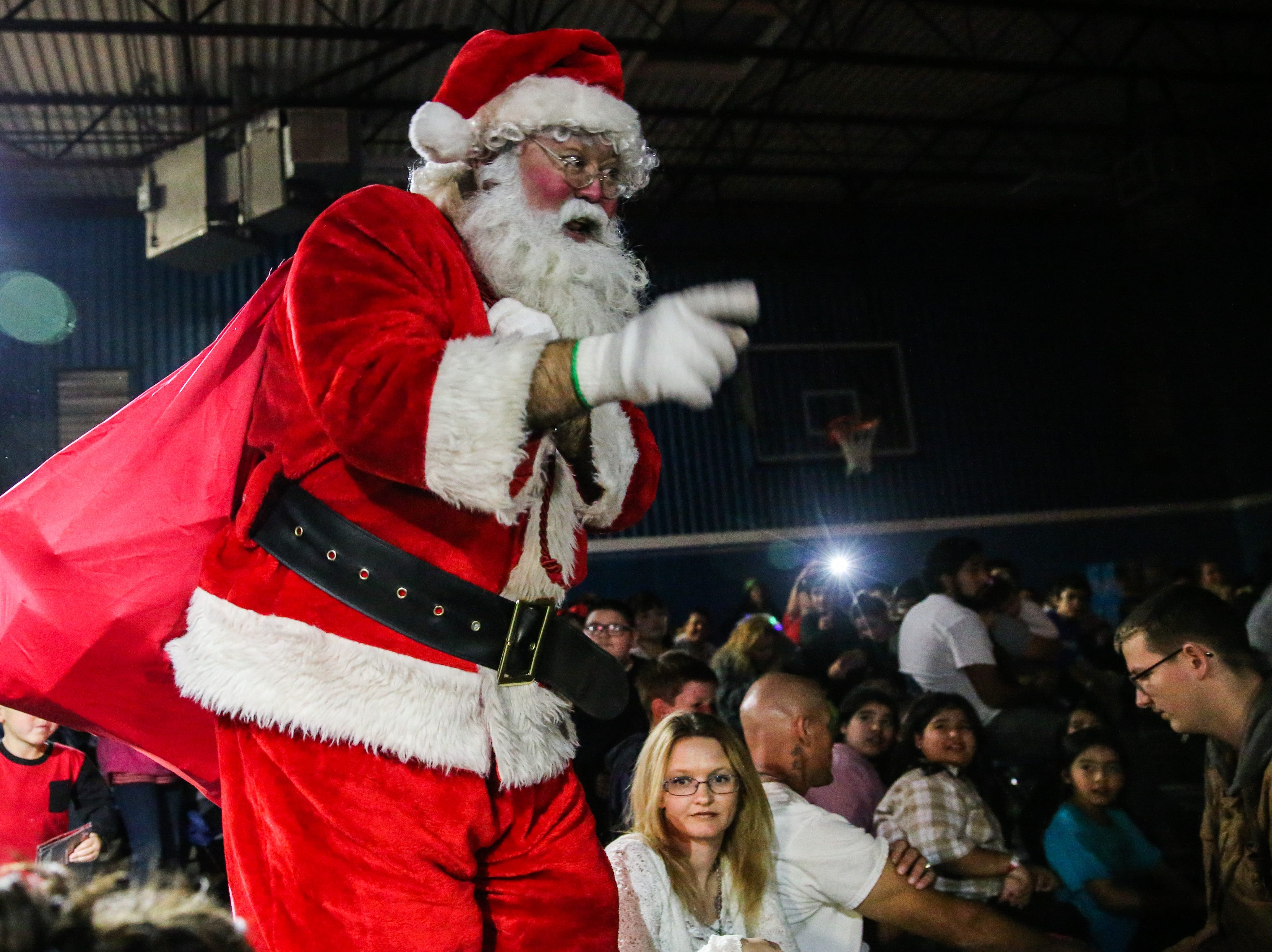 Santa makes his way through the crowd at the In the Spirit of Christmas party Saturday, Dec. 15, 2018, at the Southside Recreation Center.