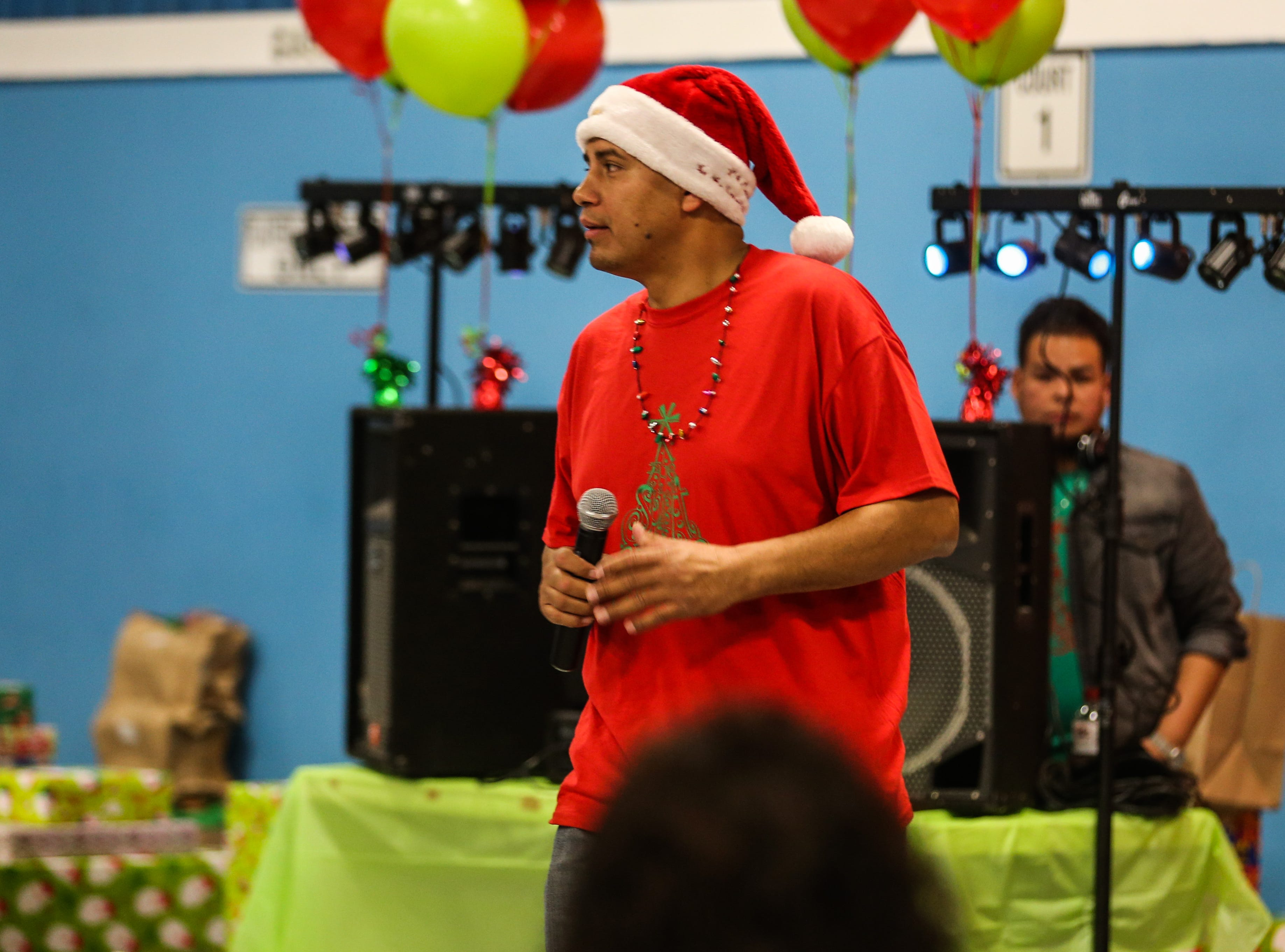 Osvaldo Martinez gets the kids ready for dance contests during the In the Spirit of Christmas party Saturday, Dec. 15, 2018, at the Southside Recreation Center.