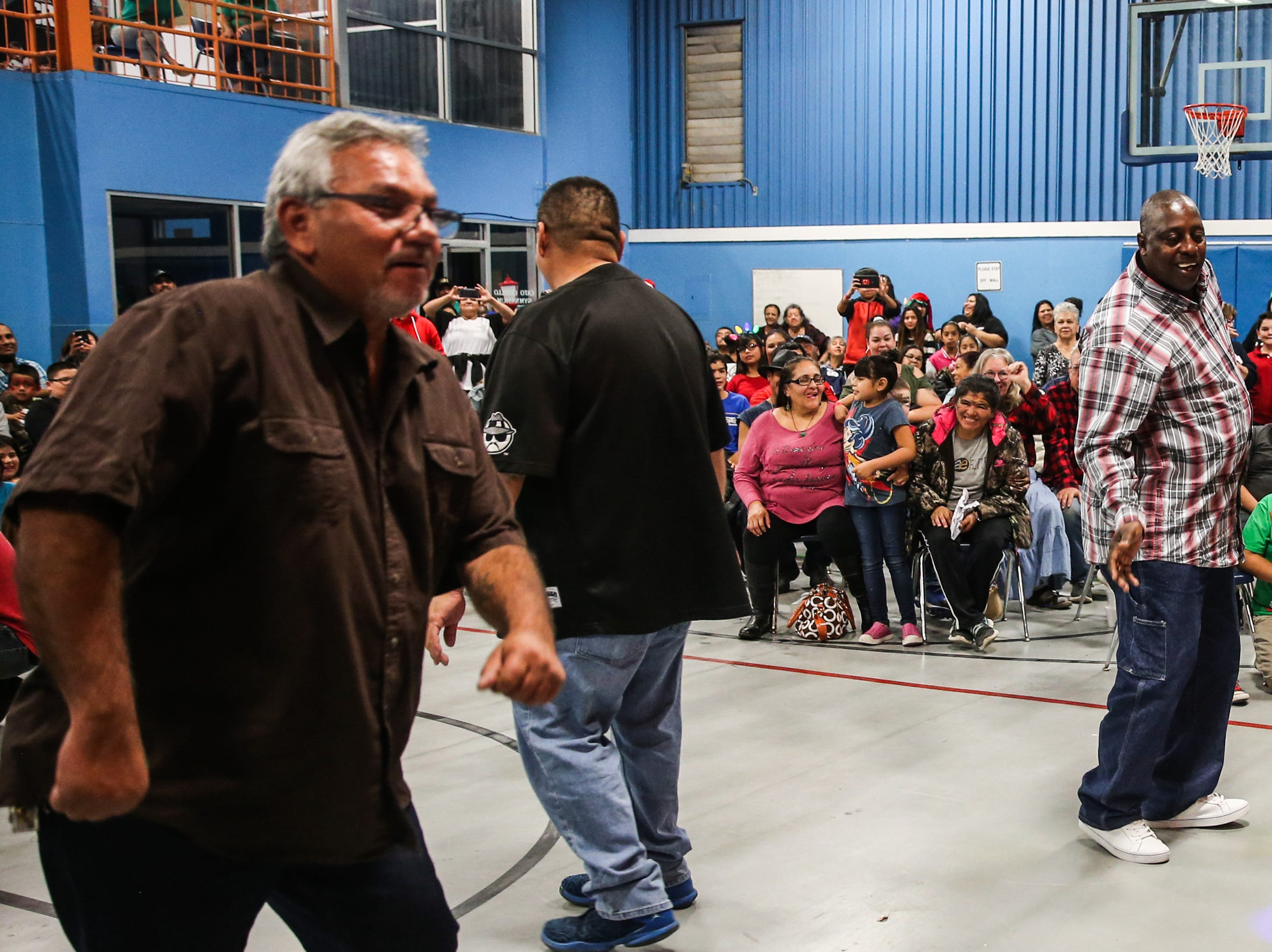 Adults show off their moves in a dance contest during the In the Spirit of Christmas party Saturday, Dec. 15, 2018, at the Southside Recreation Center.