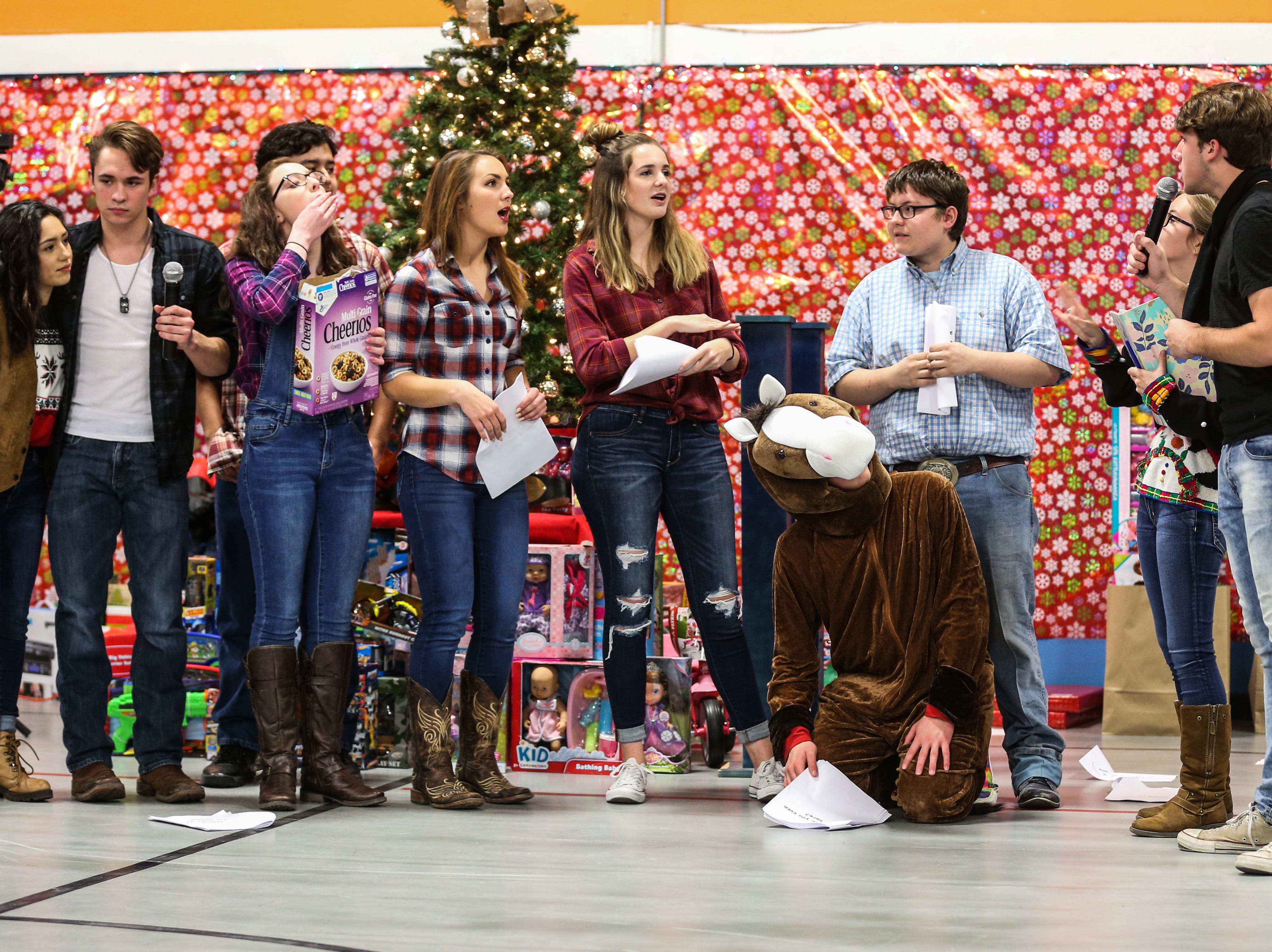 Central High theater group put on a Christmas skit during the In the Spirit of Christmas party Saturday, Dec. 15, 2018, at the Southside Recreation Center.