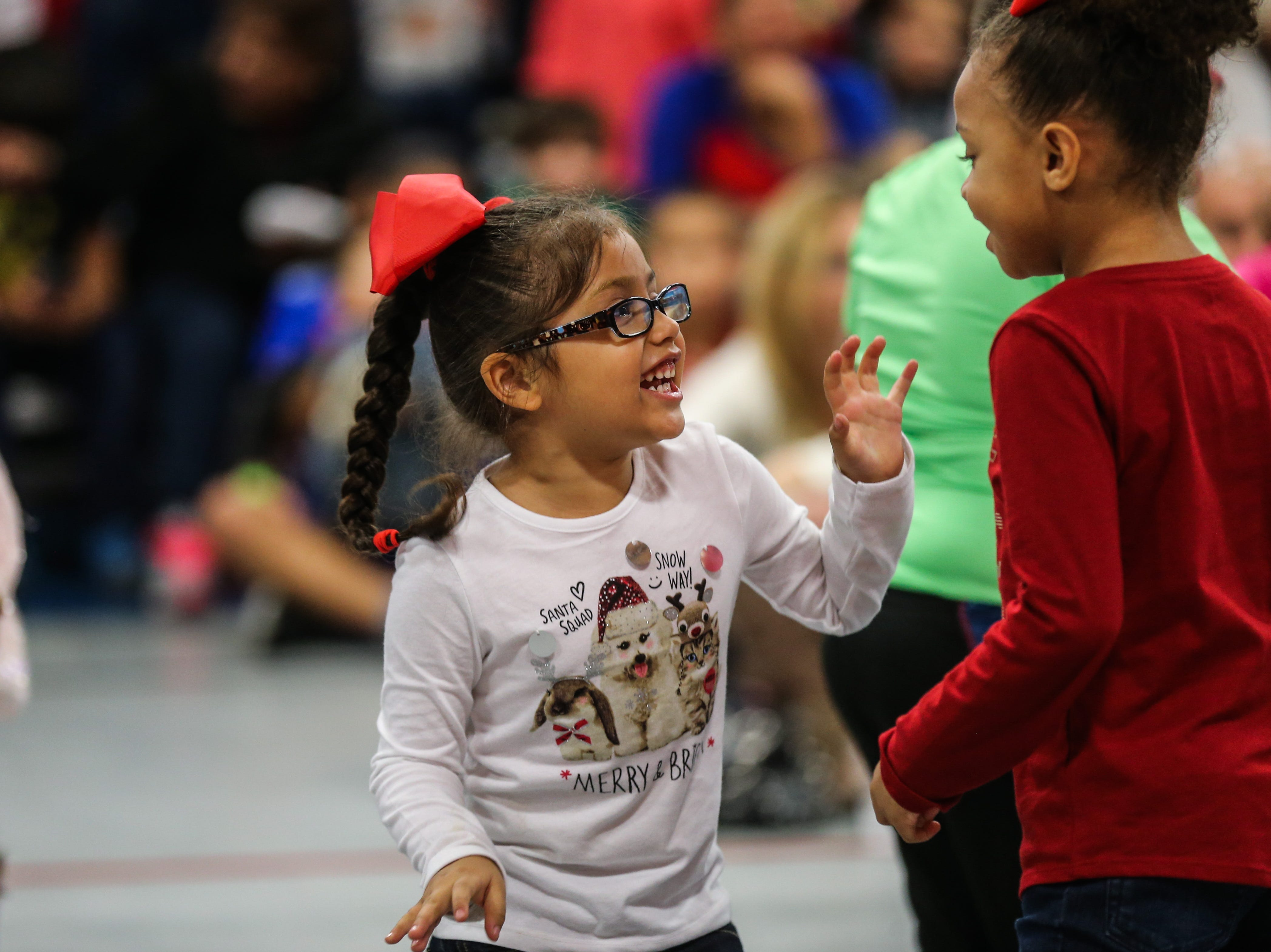 Kids dance during the In the Spirit of Christmas party Saturday, Dec. 15, 2018, at the Southside Recreation Center.