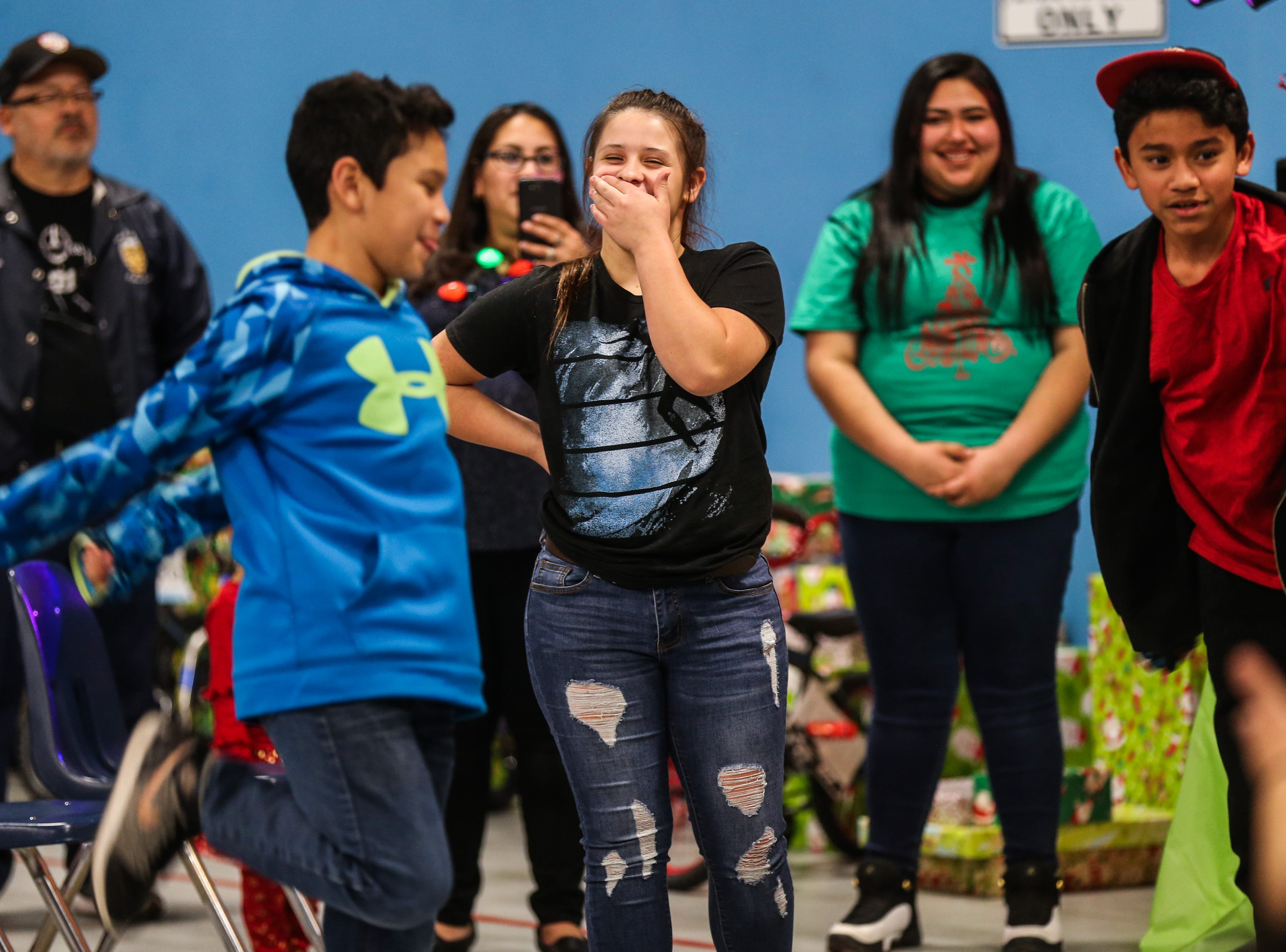 Teens show off their moves in a dance contest during the In the Spirit of Christmas party Saturday, Dec. 15, 2018, at the Southside Recreation Center.