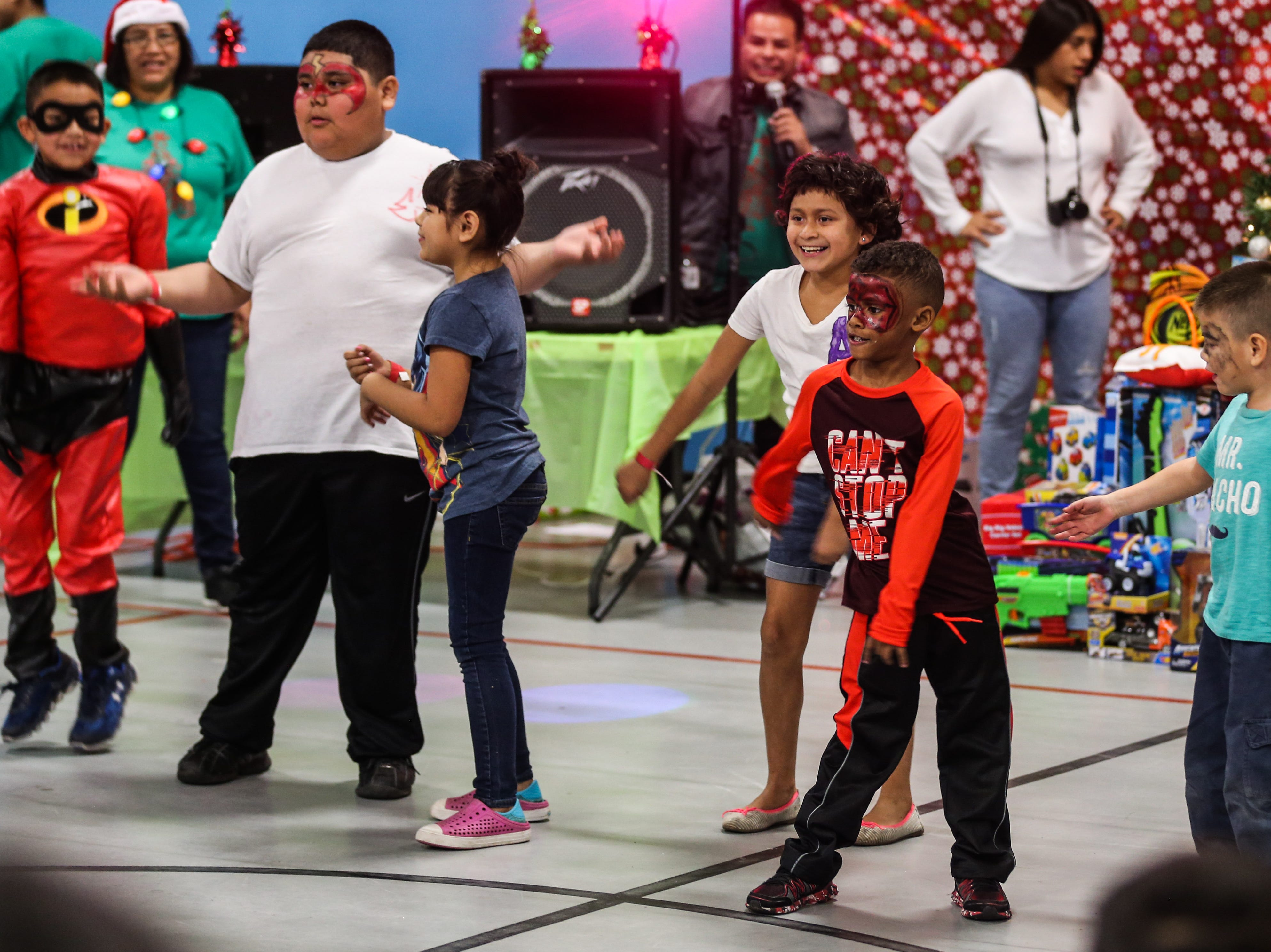 Kids dance for a contest during the In the Spirit of Christmas party Saturday, Dec. 15, 2018, at the Southside Recreation Center.