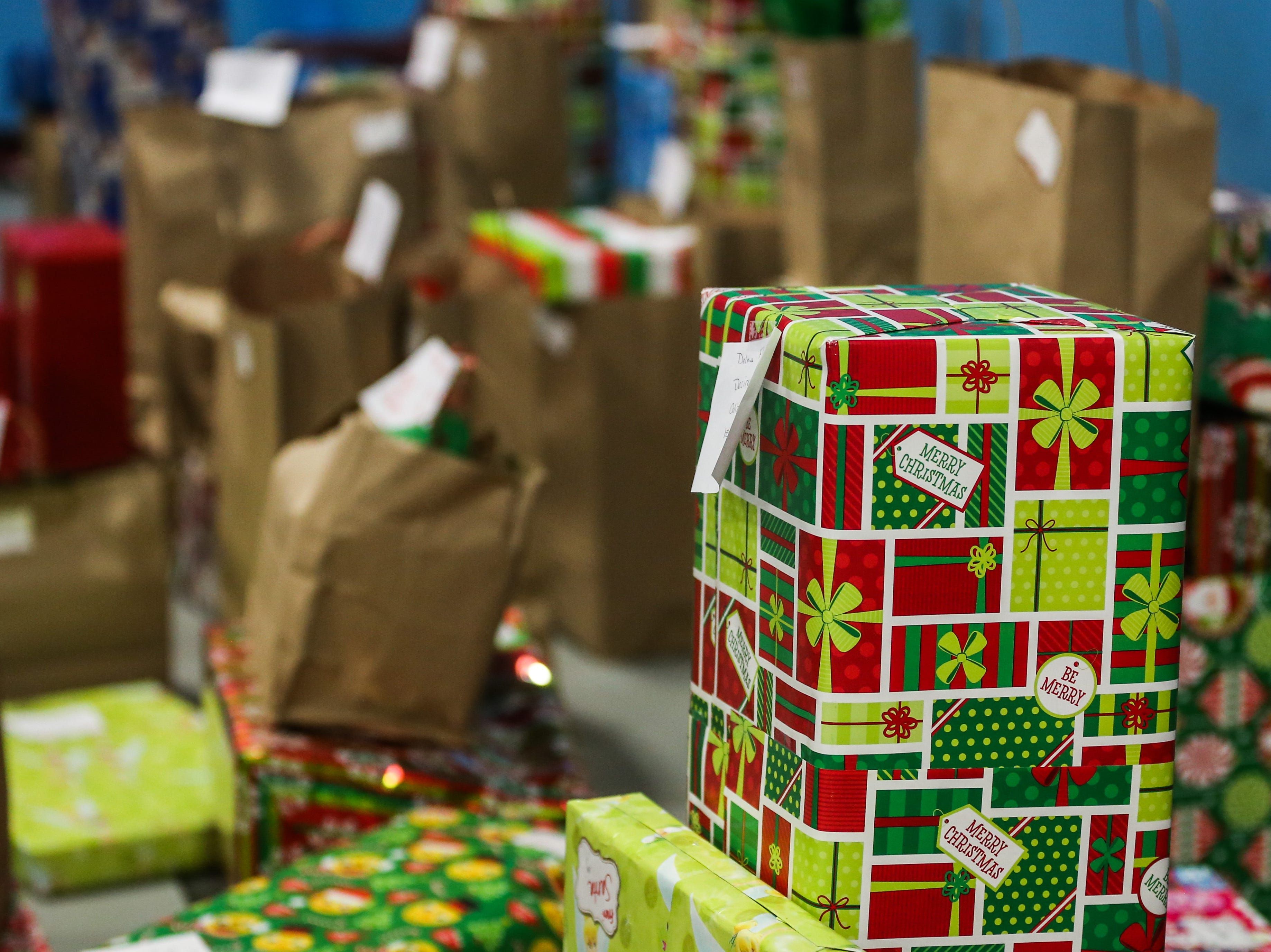 Gifts line the wall during the In the Spirit of Christmas party Saturday, Dec. 15, 2018, at the Southside Recreation Center.