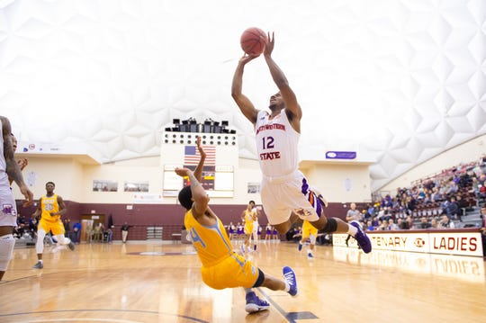 Northwestern's John Norvel goes up for two points over Southern's Aaron Ray during Saturday's SBSC Holiday Classic game at the Centenary Gold Dome.