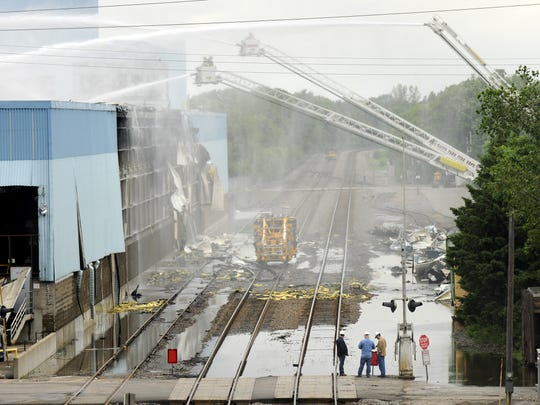 Firefighters from area department spent several days putting water on the fire at the Verso Paper Co. plant in Sartell in 2012.
