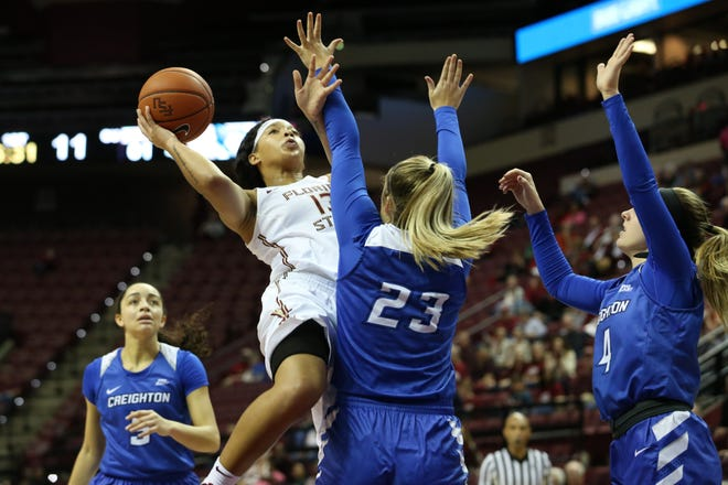 Florida State Seminoles guard Nausia Woolfolk (13) shoots from inside the paint while Creighton Bluejays forward Morgan Turner (23) tries to block her shot as the Florida State Seminoles host the Creighton Bluejays for women's basketball at the Tucker Civic Center, Sunday, Dec. 16, 2018.