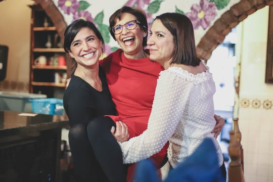 """District 8 city Rep. Cecilia """"Cissy"""" Lizarraga is picked up by her two daughters, Marisa Ong and Vanessa Lizarraga, as they celebrate her victory Saturday, Dec. 15, 2018, at G&R Restaurant."""