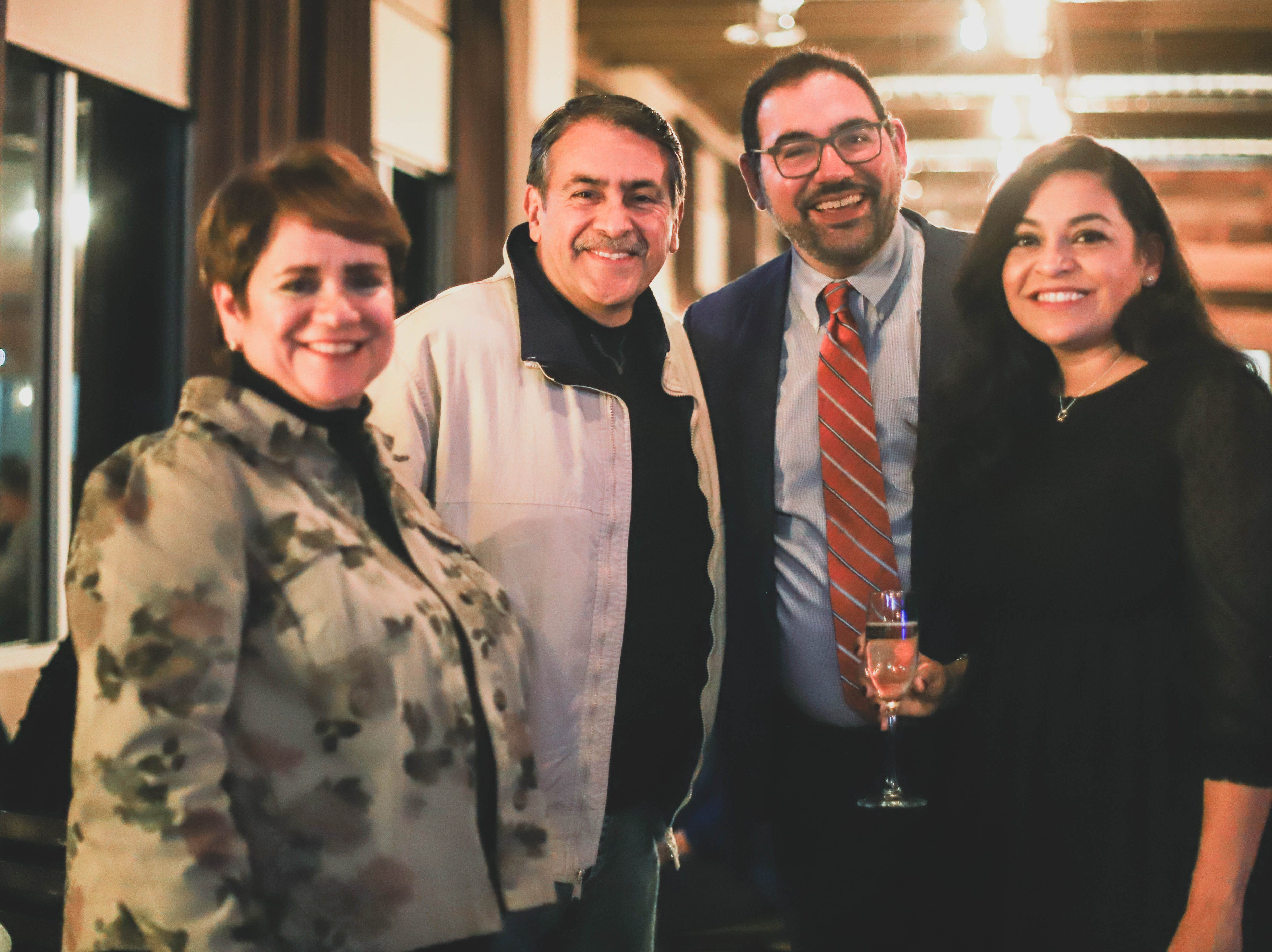 District 1 city Rep. Peter Svarzbein poses with his girlfriend,Tatiana Avila, District 7 city Rep. Henry Rivera andvolunteer Fabiola Campos-Neri at his election watch party Saturday, Dec. 15, 2018, at Holy Grail.