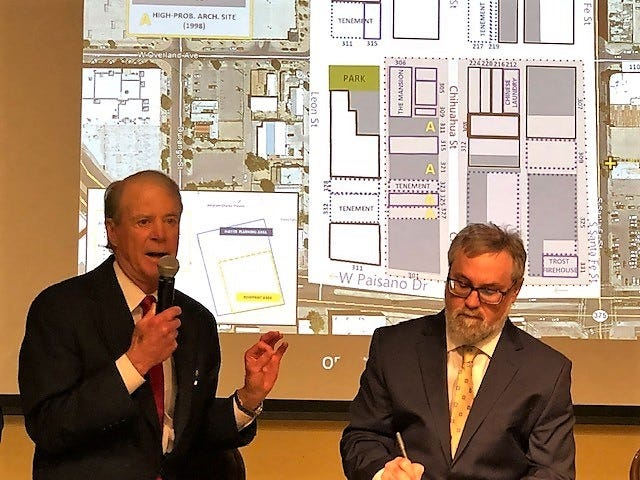 Retired Houston oilman and historic preservationist  J.P. Bryan talks about saving the historic Duranguito neighborhood in Downtown El Paso, shown on background map, at a Dec. 15 conference. Troy Ainsworth, former El Paso historic preservation officer, is next to him.