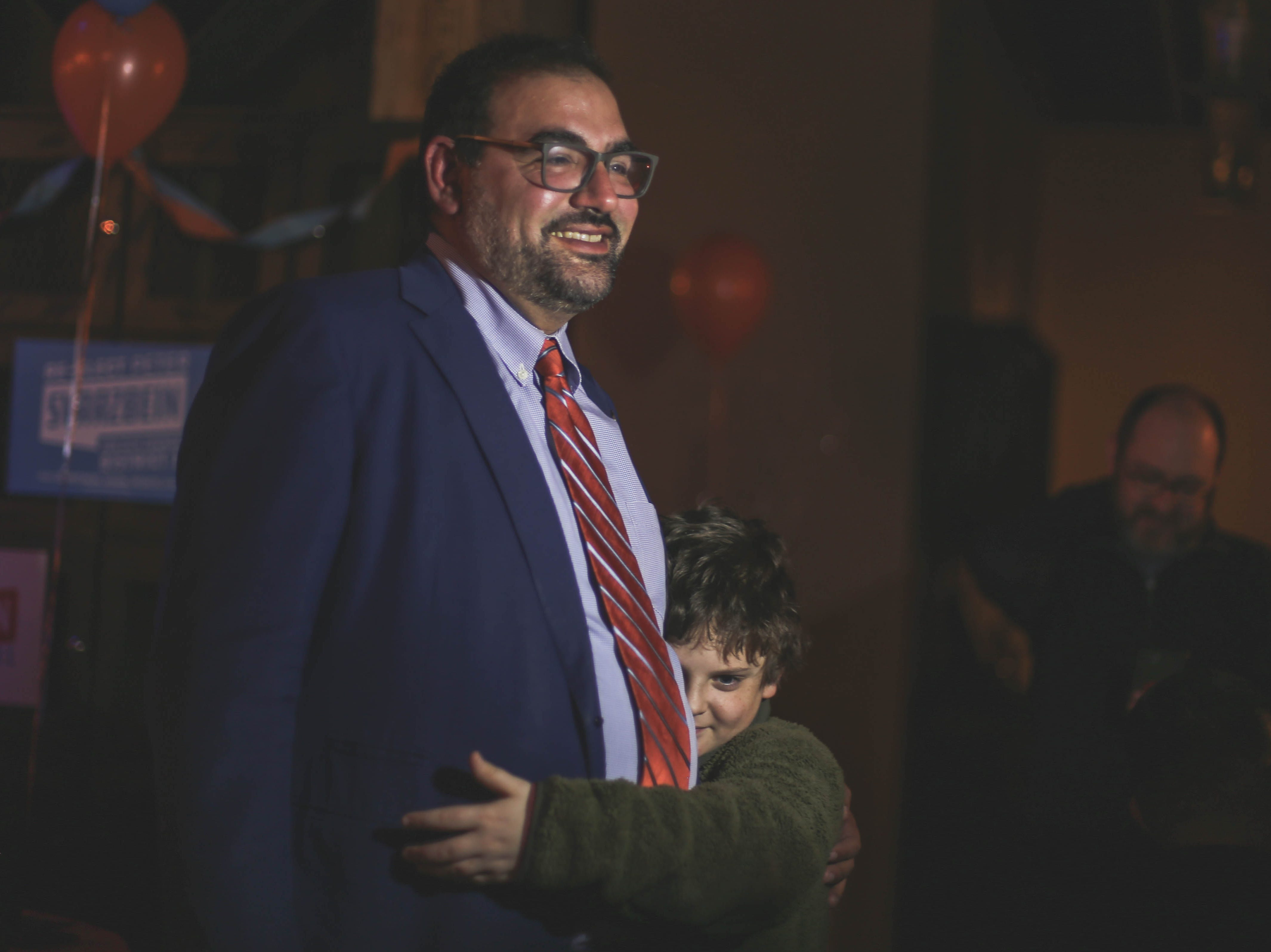 District 1 city Rep. Peter Svarzbein and family friend Kameron Scheiner celebrate his re-election Saturday, Dec. 15, 2018, at Holy Grail.