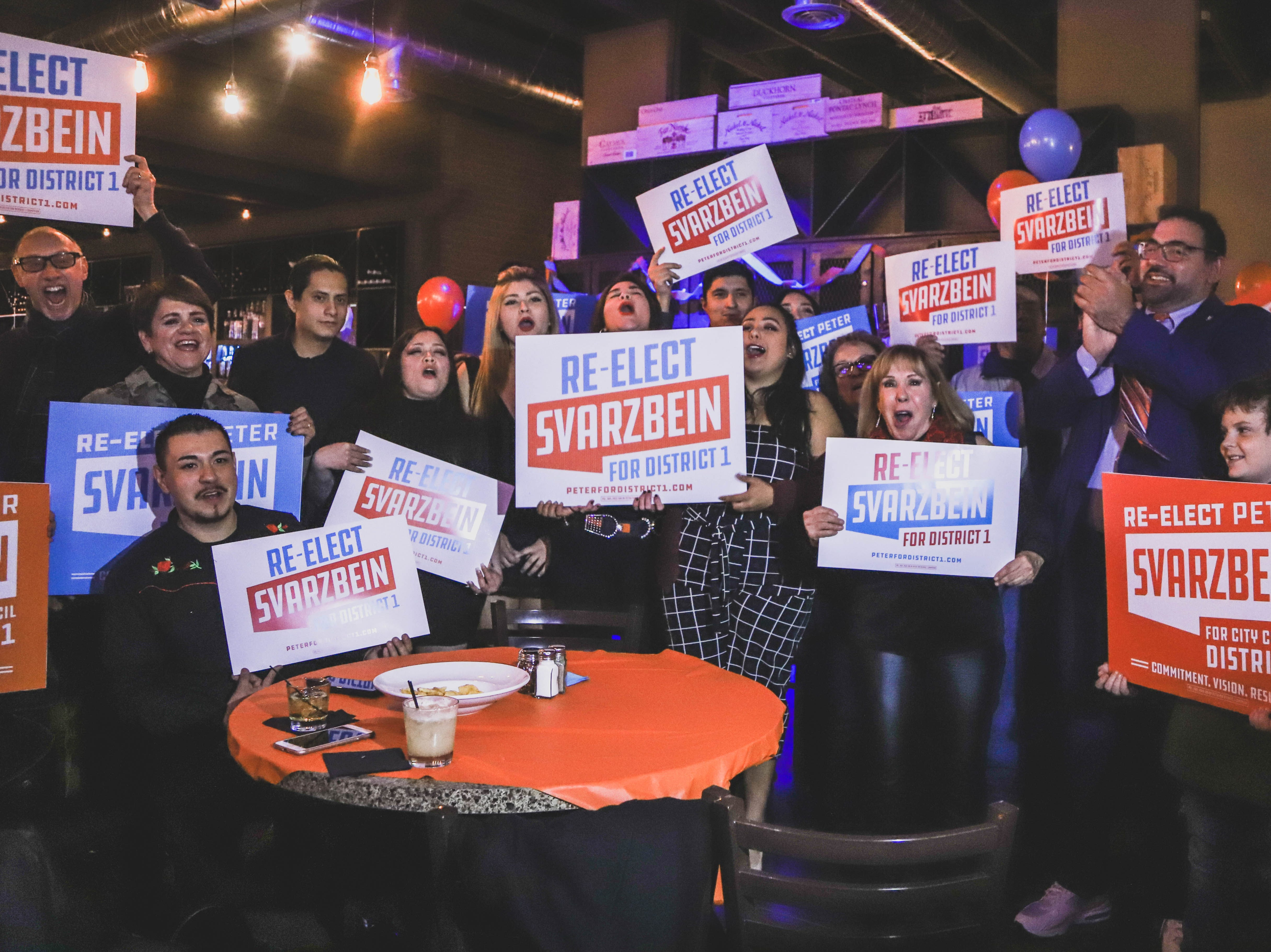 District 1 City Rep. District 1 Peter Svarzbein, second from right,celebrates his re-election at his watch party Saturday, Dec. 15, 2018, at Holy Grail.
