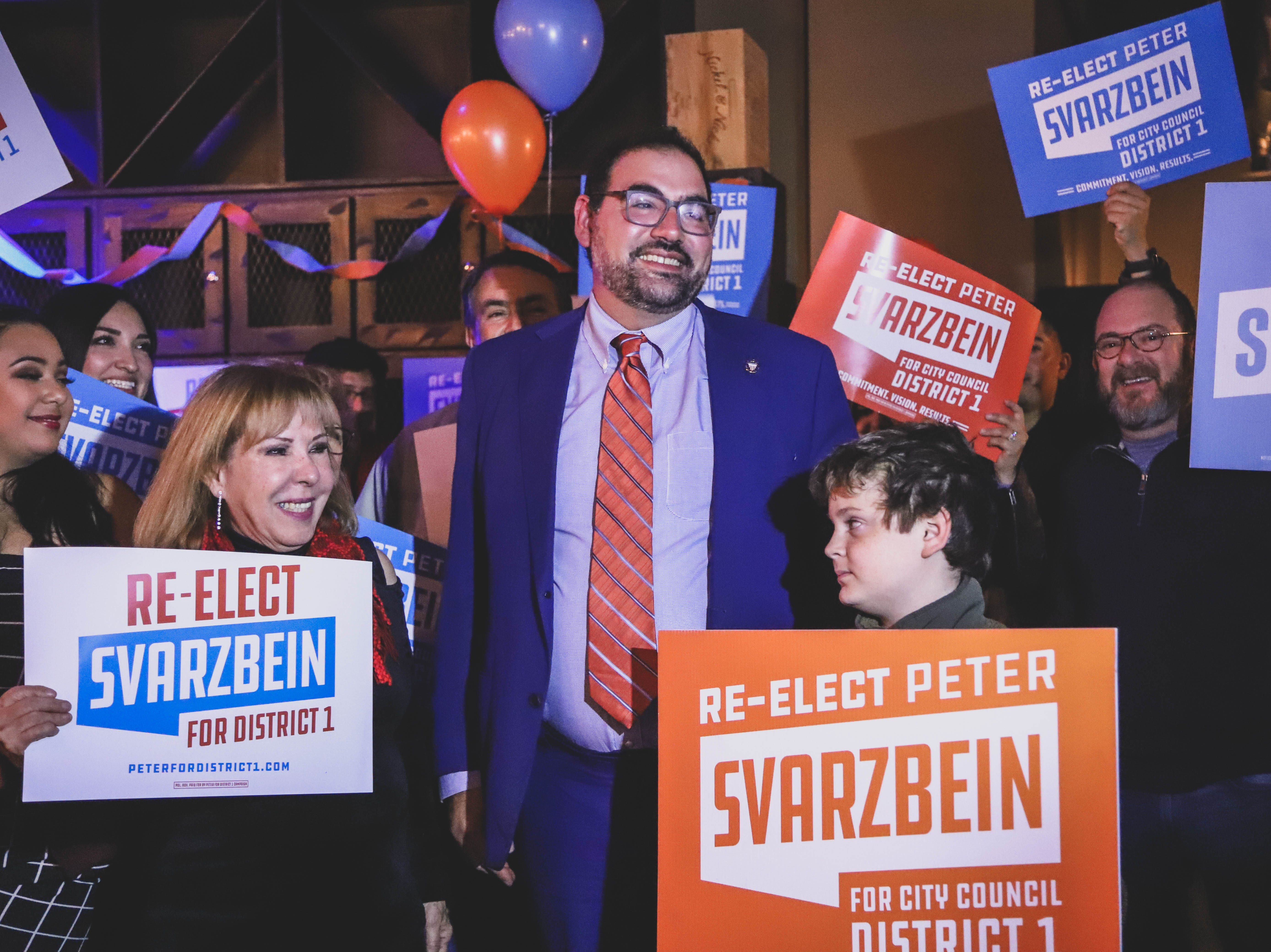 District 1 city Rep. Peter Svarzbein, center,celebrates his re-election at his watch party Saturday, Dec. 15, 2018, at Holy Grail.