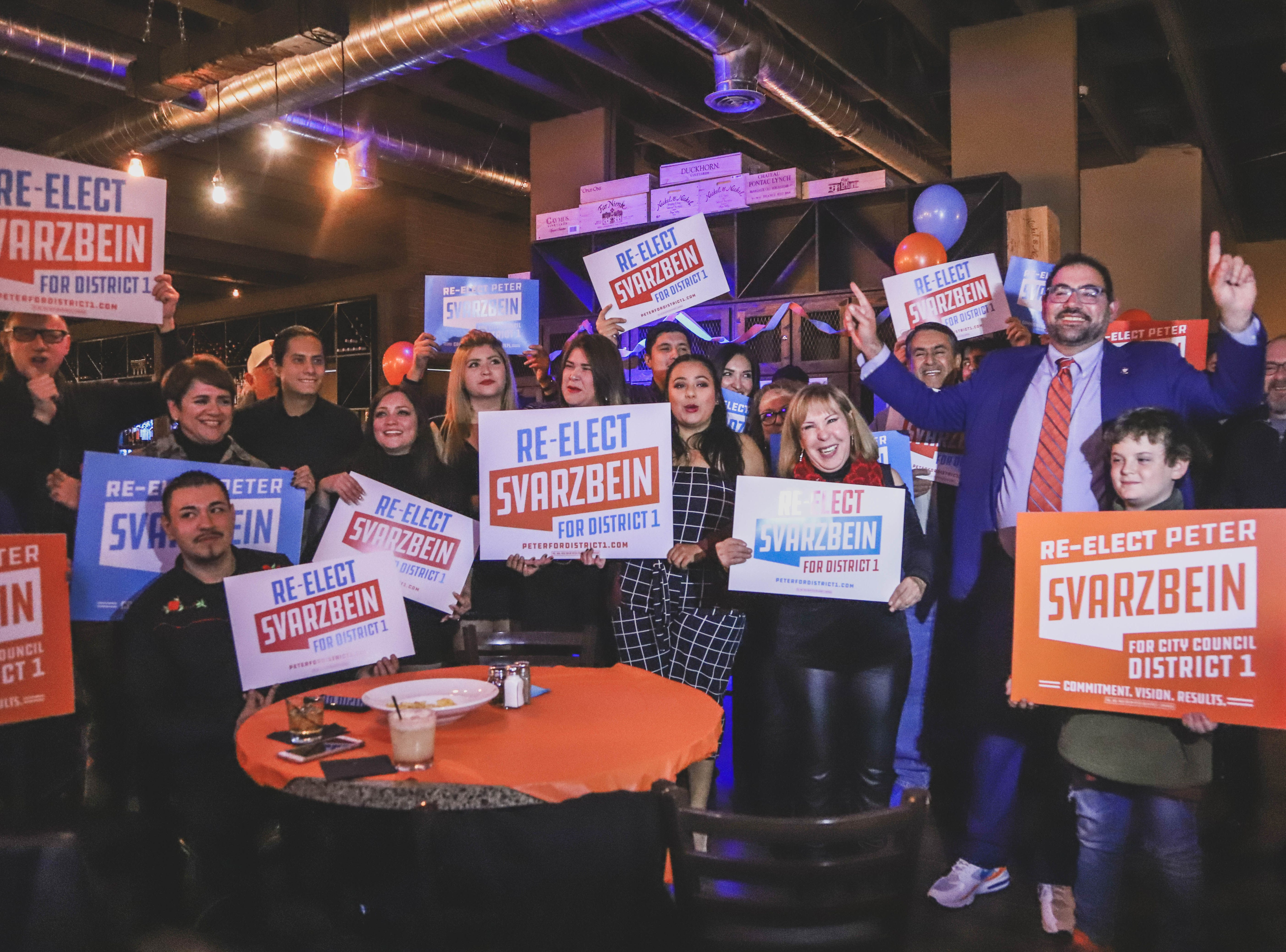 District 1 city Rep. Peter Svarzbein, third from right,celebrates his re-election at his watch party Saturday, Dec. 15, 2018, at Holy Grail.