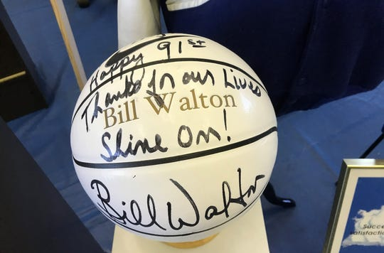 A basketball with a happy 91st Birthday message from Bill Walton was on display at Lou Cvijanovich's memorial Saturday at Santa Clara High.