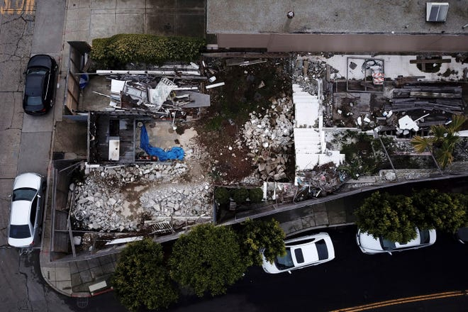 This Friday photo shows an aerial view of a demolished house in San Francisco. A man who illegally demolished the house designed by the modernist architect Richard Neutra was ordered to rebuild it exactly as it was. The city Planning Commission also ordered Ross Johnston to add a sidewalk plaque telling the entire saga of the house's origins in the 1930s, its demolition and replication.