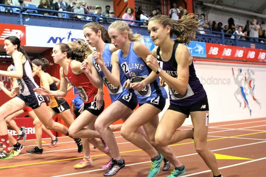 Ursuline's Sarah (3) and Lily (2) Flynn and Pennsylvania's Marlee Starliper (r) during the girls invitational mile at the Coaches Hall of Fame Invitational at The Armory.