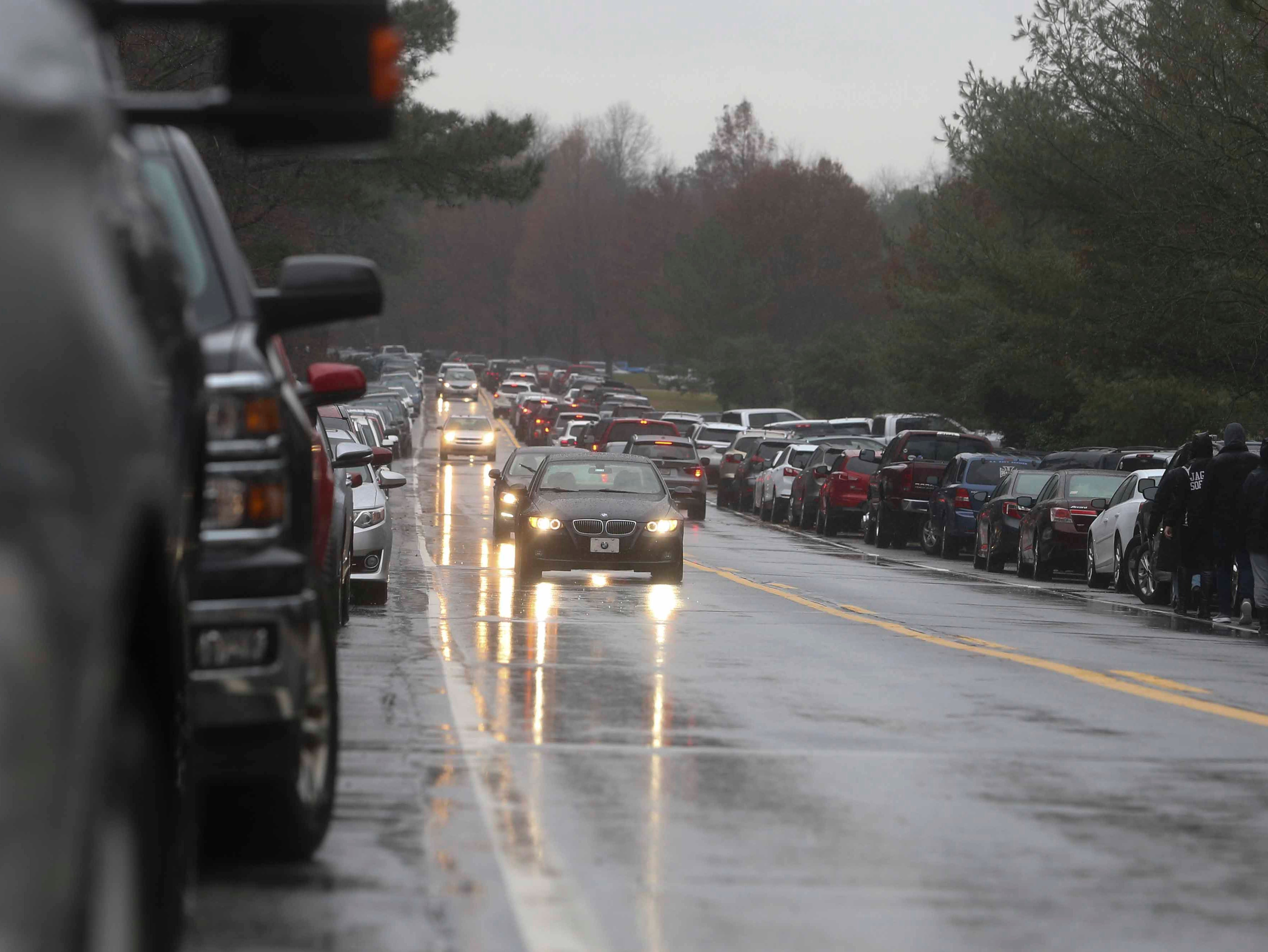 Cars line Chesapeake City Road as a couple thousand of volunteers flood the Delaware Veterans Memorial Cemetery in Bear to volunteer as part of Wreaths Across America Saturday. The grave-decorating effort was duplicated at the state veterans memorial cemetery in Millsboro and throughout the nation at more than 1400 locations Saturday.