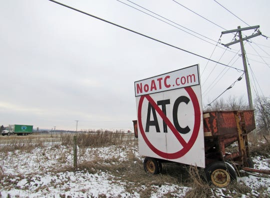 A grain wagon supports a sign along Highway 18-151 near Ridgeway. Signs against the proposed 345-kilovolt Cardinal-Hickory Creek transmission line are prolific along both routes proposed by American Transmission Co. of Pewaukee, ITC Midwest of Cedar Rapids, Iowa, and Dairyland Power Cooperative of La Crosse.