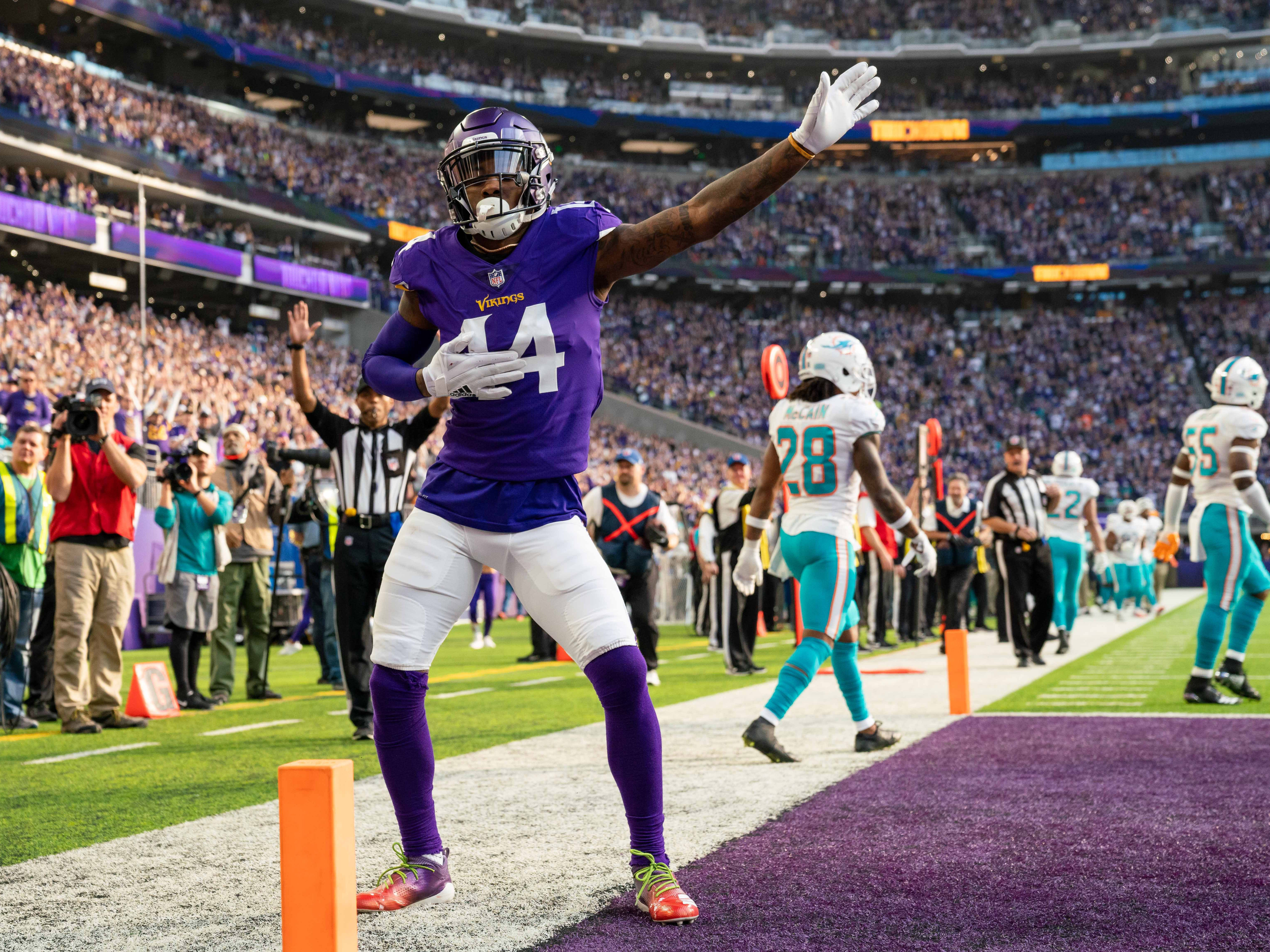 Vikings wide receiver Stefon Diggs celebrates his touchdown in the first quarter against the Dolphins.