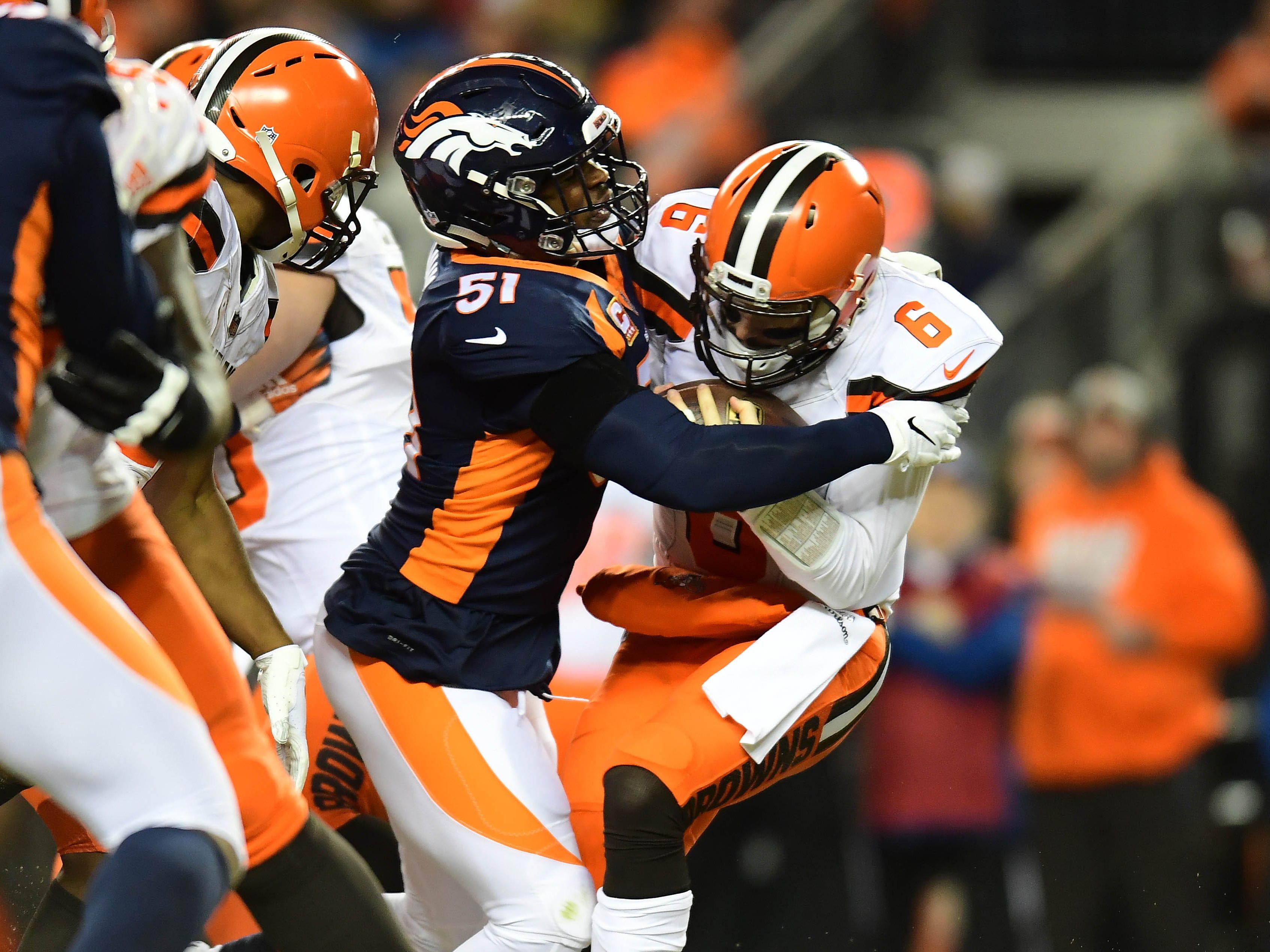 Denver Broncos inside linebacker Todd Davis (51) sacks Cleveland Browns quarterback Baker Mayfield (6) in the second quarter at Broncos Stadium at Mile High.