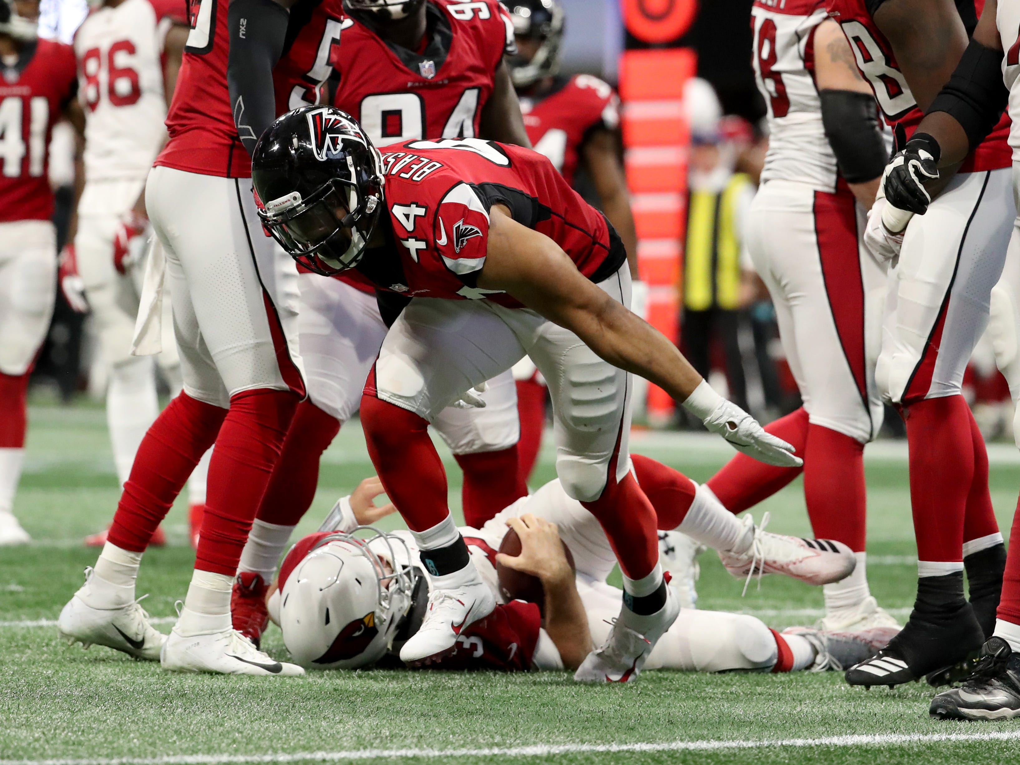 Atlanta Falcons defensive end Vic Beasley (44) reacts after sacking Arizona Cardinals quarterback Josh Rosen (3) in the fourth quarter at Mercedes-Benz Stadium.