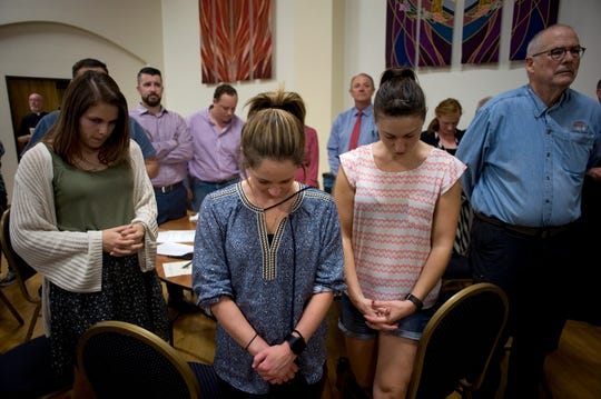 People pray during a gathering convened by San Diego Catholic Bishop Robert McElroy at the St. Joseph Cathedral on Oct. 3.
