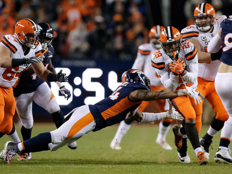 Cleveland Browns running back Duke Johnson Jr. (29) runs through the tackle of Denver Broncos inside linebacker Brandon Marshall (54) in the second quarter at Broncos Stadium at Mile High.